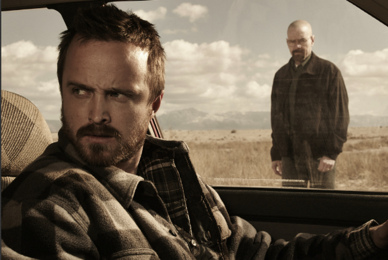 breaking bad season 5: jesse sits in a car as a broken up walt watches through the window