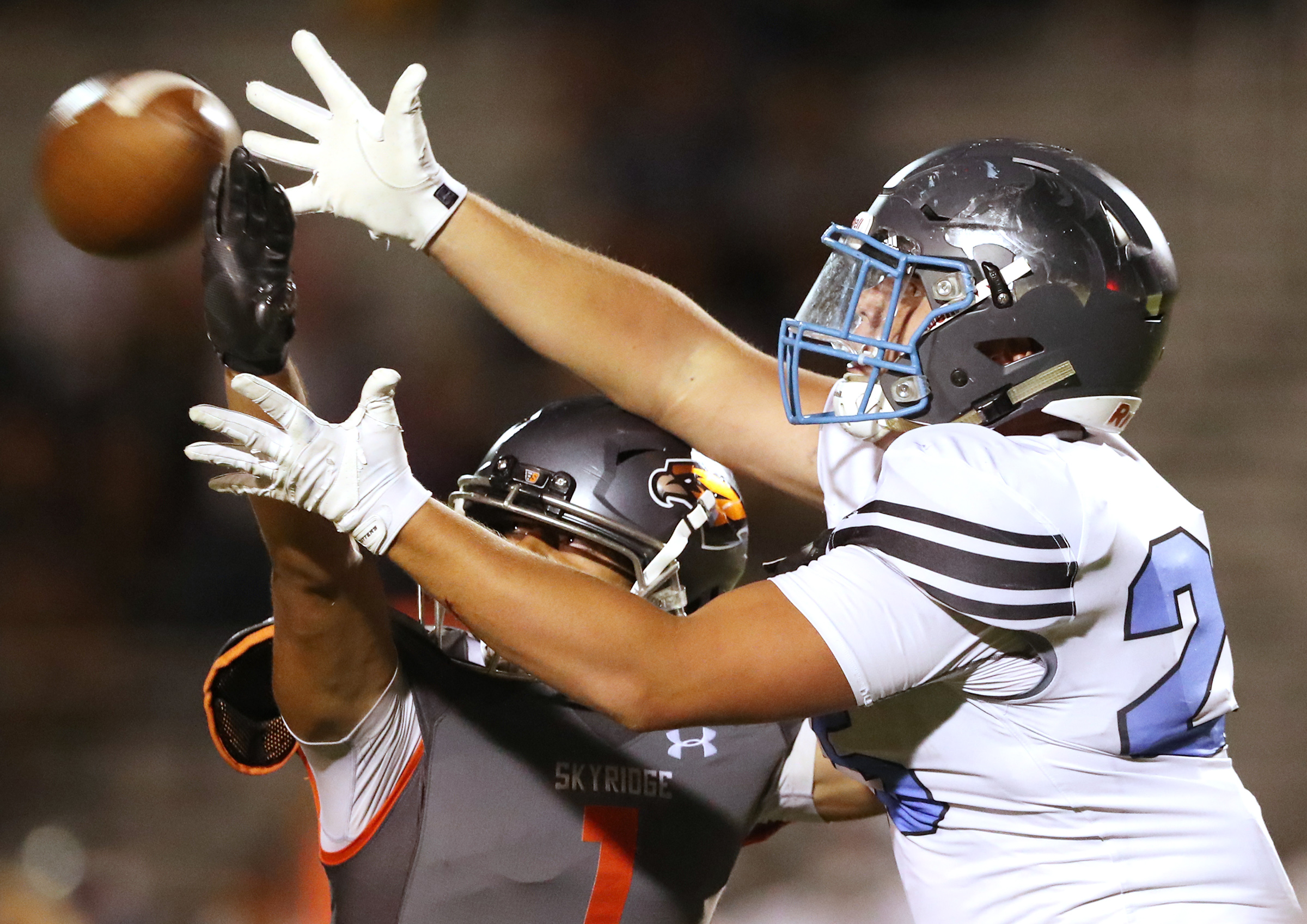 Skyridge's Malae Tanuvasa knocks the ball away from Sky View's Jacob Zollinger as they play a high school football game in Lehi on Friday, Aug. 23, 2019. Skyridge won 18-10.