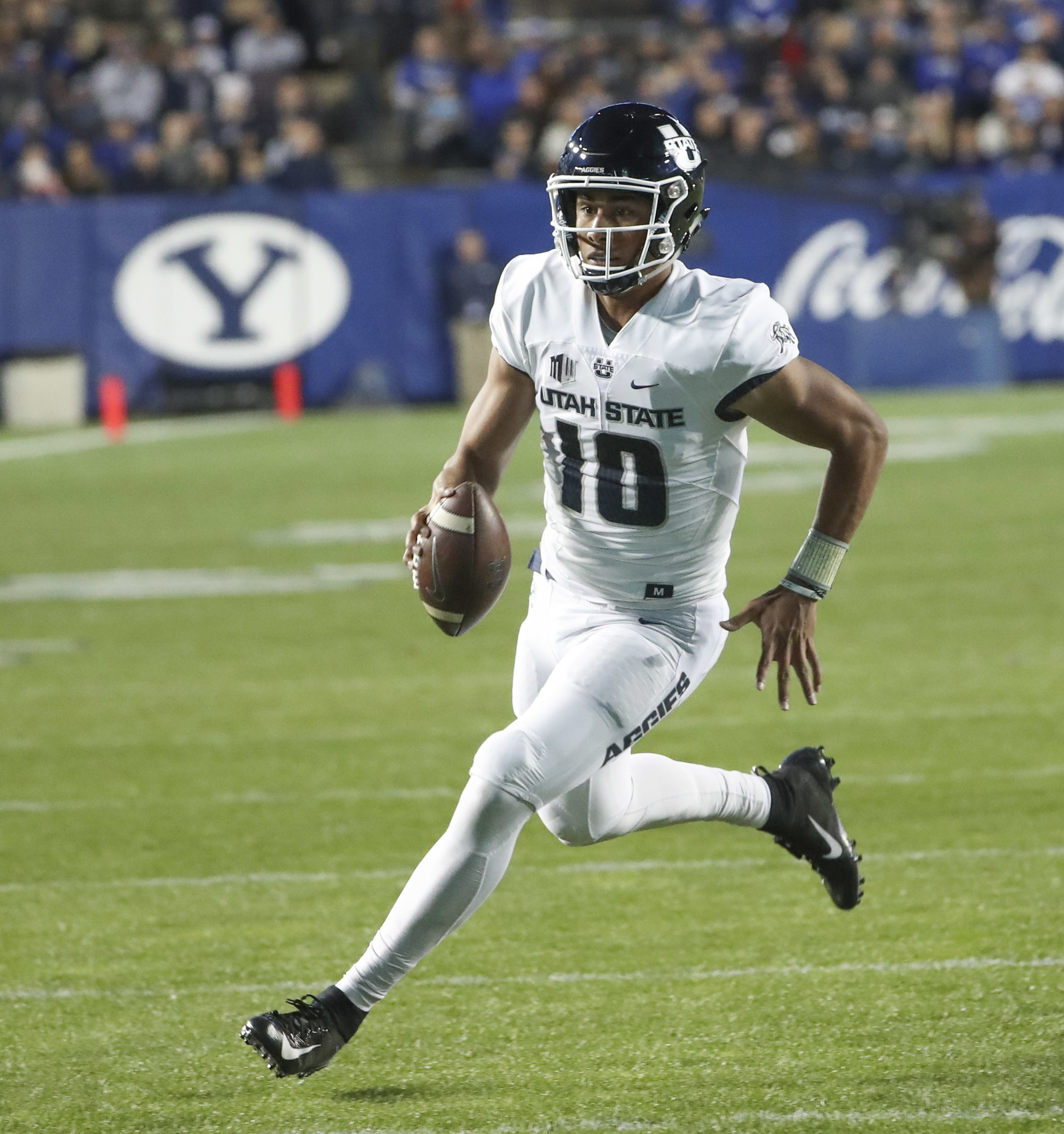 Utah State Aggies quarterback Jordan Love (10) sprints out of the pocket for a big gain during the Utah State versus BYU football game at LaVell Edwards Stadium in Provo on Friday, Oct. 5, 2018.