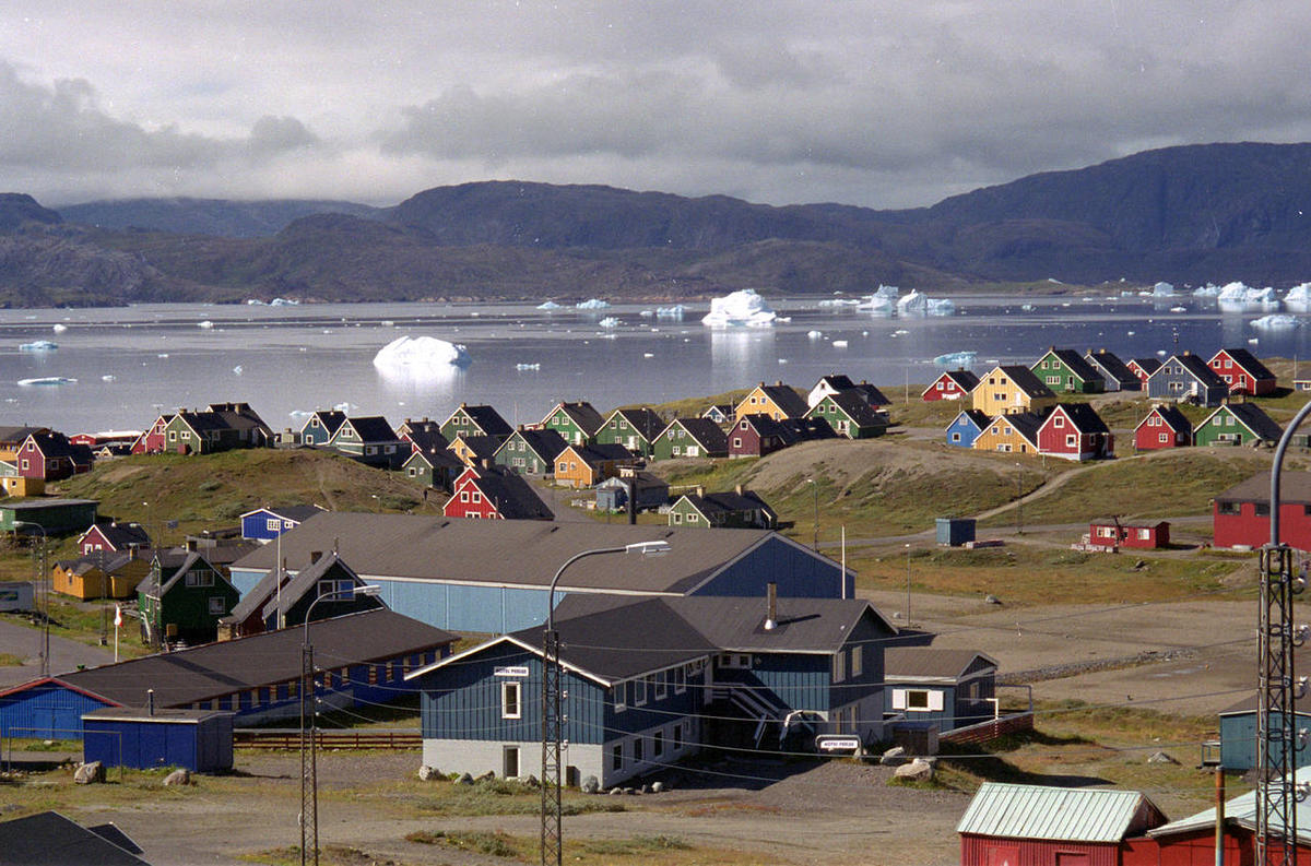 Giant icebergs float in the fjord in Narsaq, southern Greenland. Greenland's mineral wealth is unlikely to help it achieve economic independence from Denmark, the dream of many Inuits on the Arctic island, according to an independent report released Frida