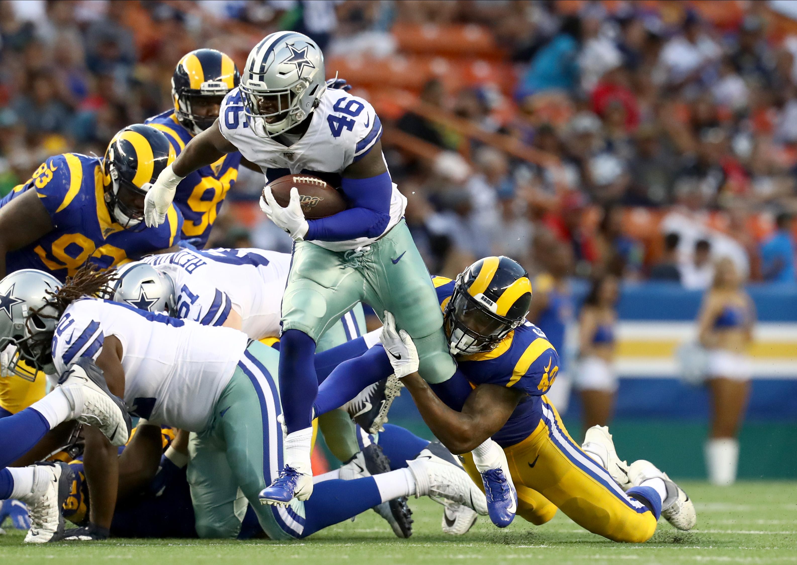 Los Angeles Rams EDGE Josh Carraway brings down Dallas Cowboys RB Jordan Chunn, Aug. 17, 2019.