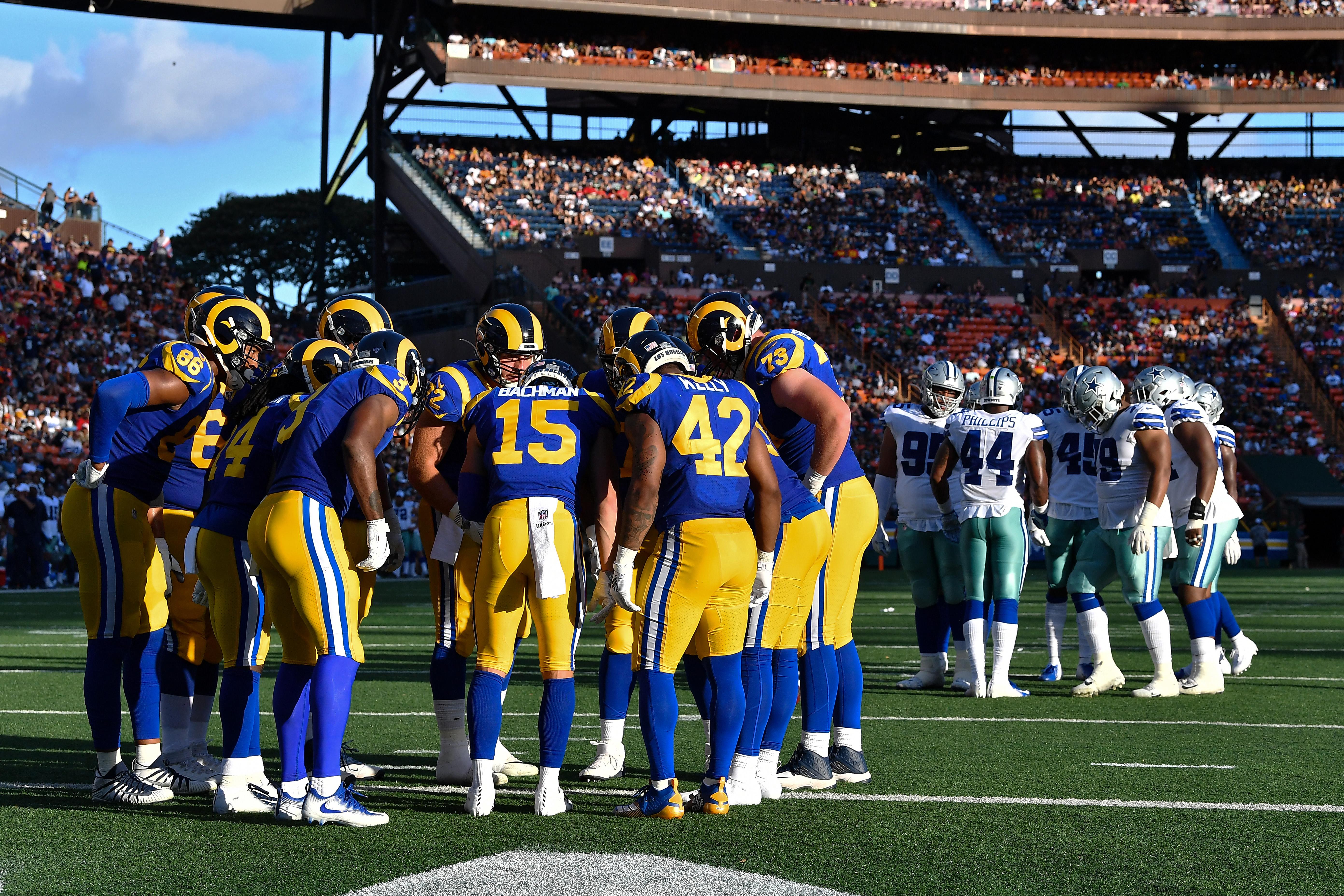 The Los Angeles Rams huddle against the Dallas Cowboys in the preseason Week 2 game in Honolulu, Hawaii, Aug. 17, 2019.