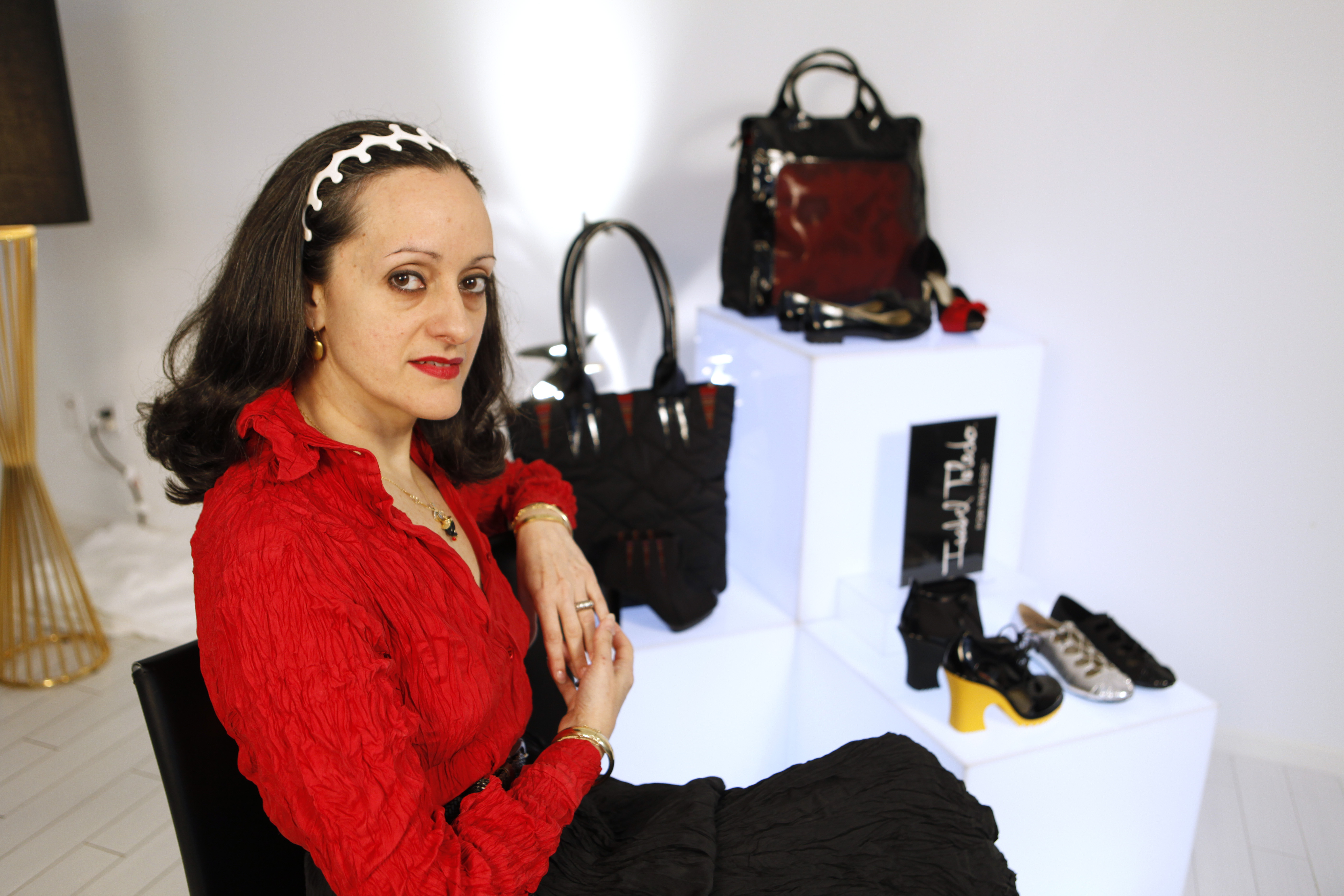 Designer Isabel Toledo poses with her shoes and handbags designed for Payless ShoeSource in Miami Beach, Florida, in 2010.