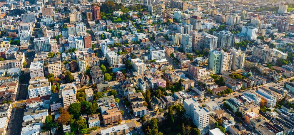 An aerial photo of a residential neighborhood in San Francisco, surveying mostly colorful low-rise homes.