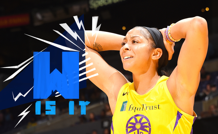 Candace Parker of the Los Angeles Sparks puts her hands behind her head as she reacts to a play during a game.