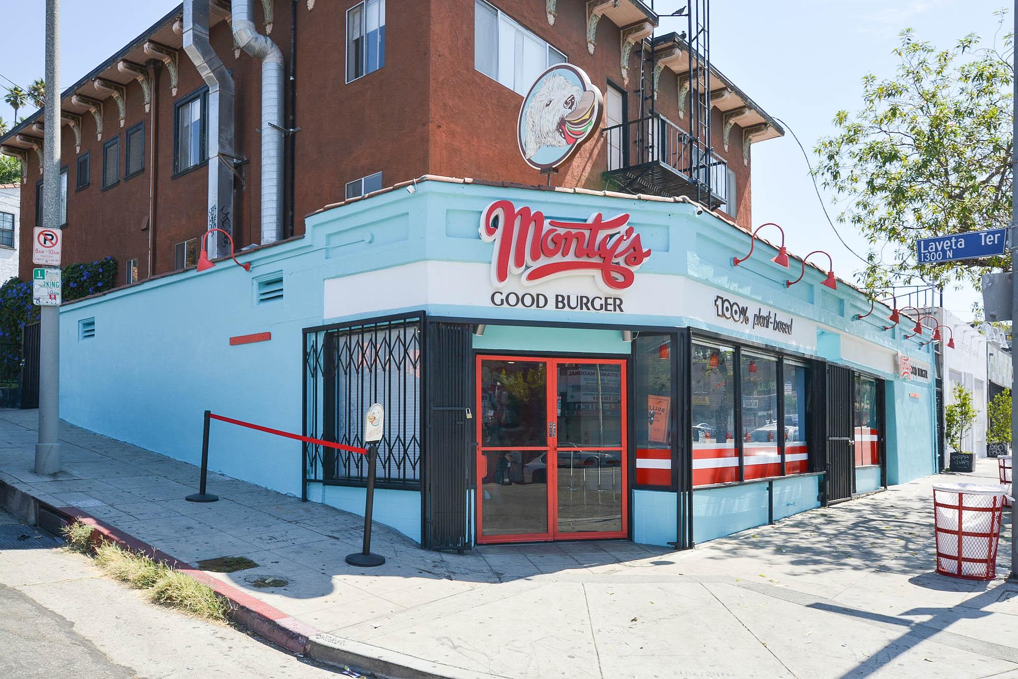The light blue front door and walls of Monty's Good Burger.