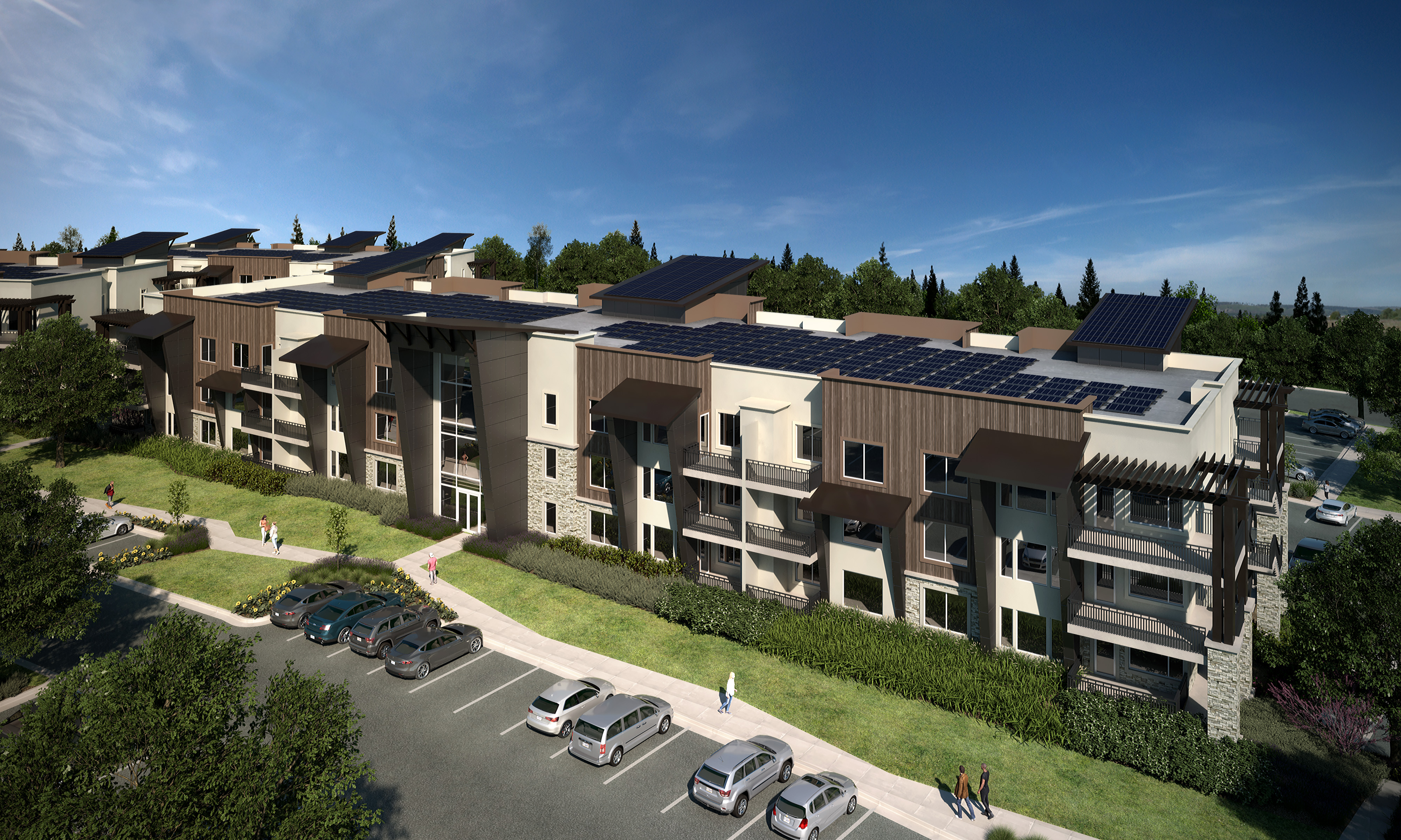 A modern rental community featuring contemporary facades and rooftop solar panels.