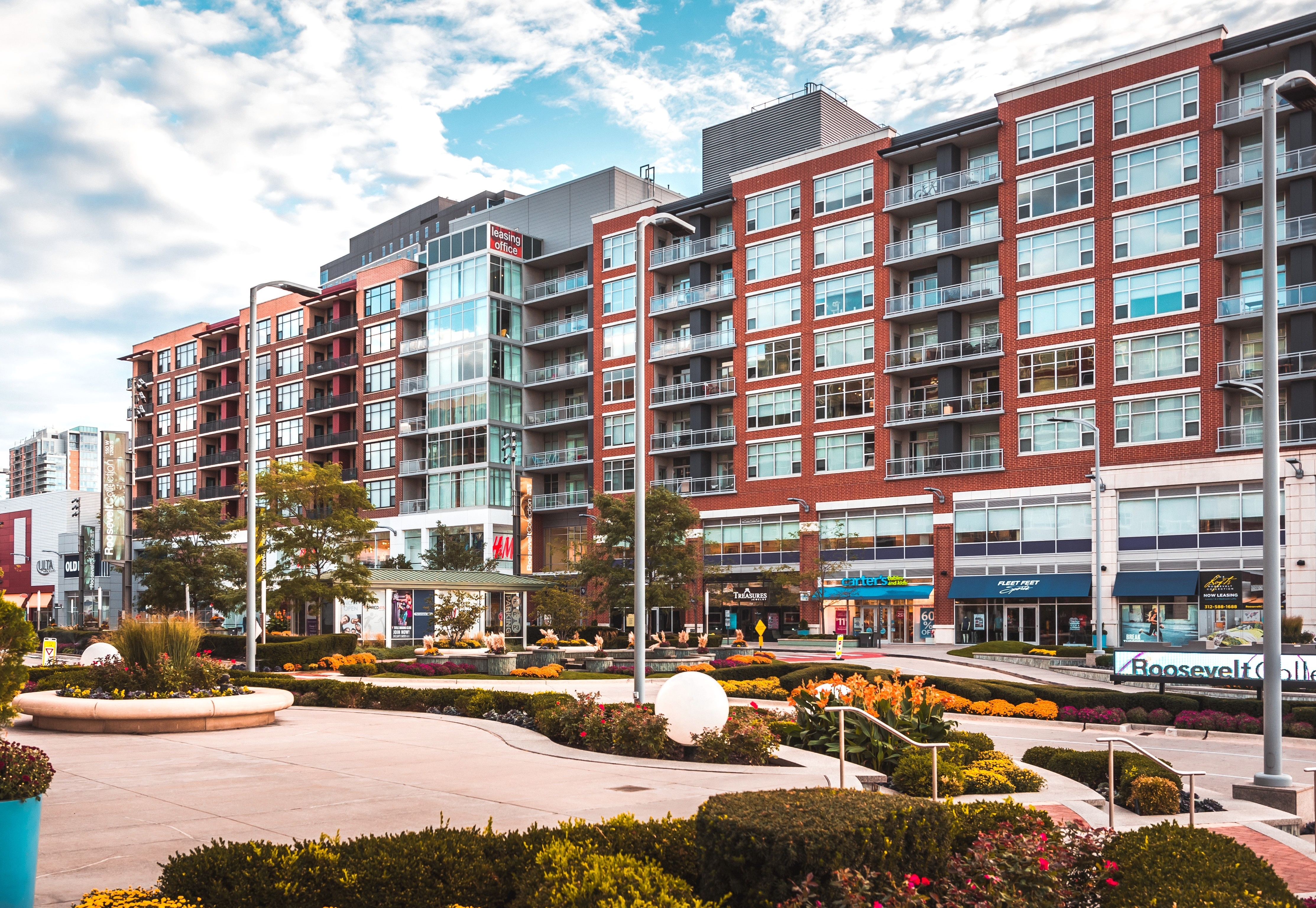 An outdoor shoot of a lifestyle center with residential units.