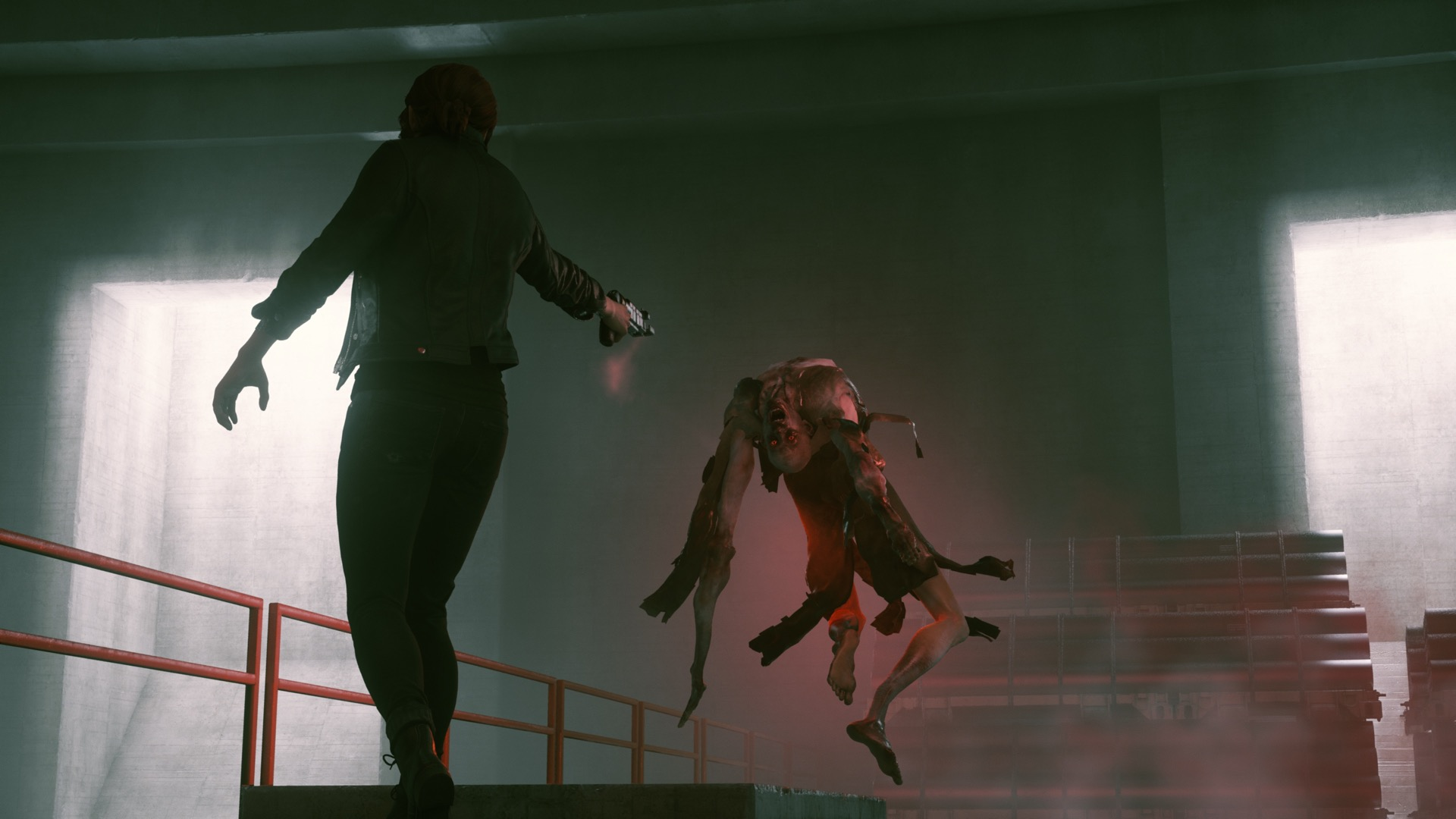Control's protagonist, Jesse, aims her gun at a grotesque, floating enemy