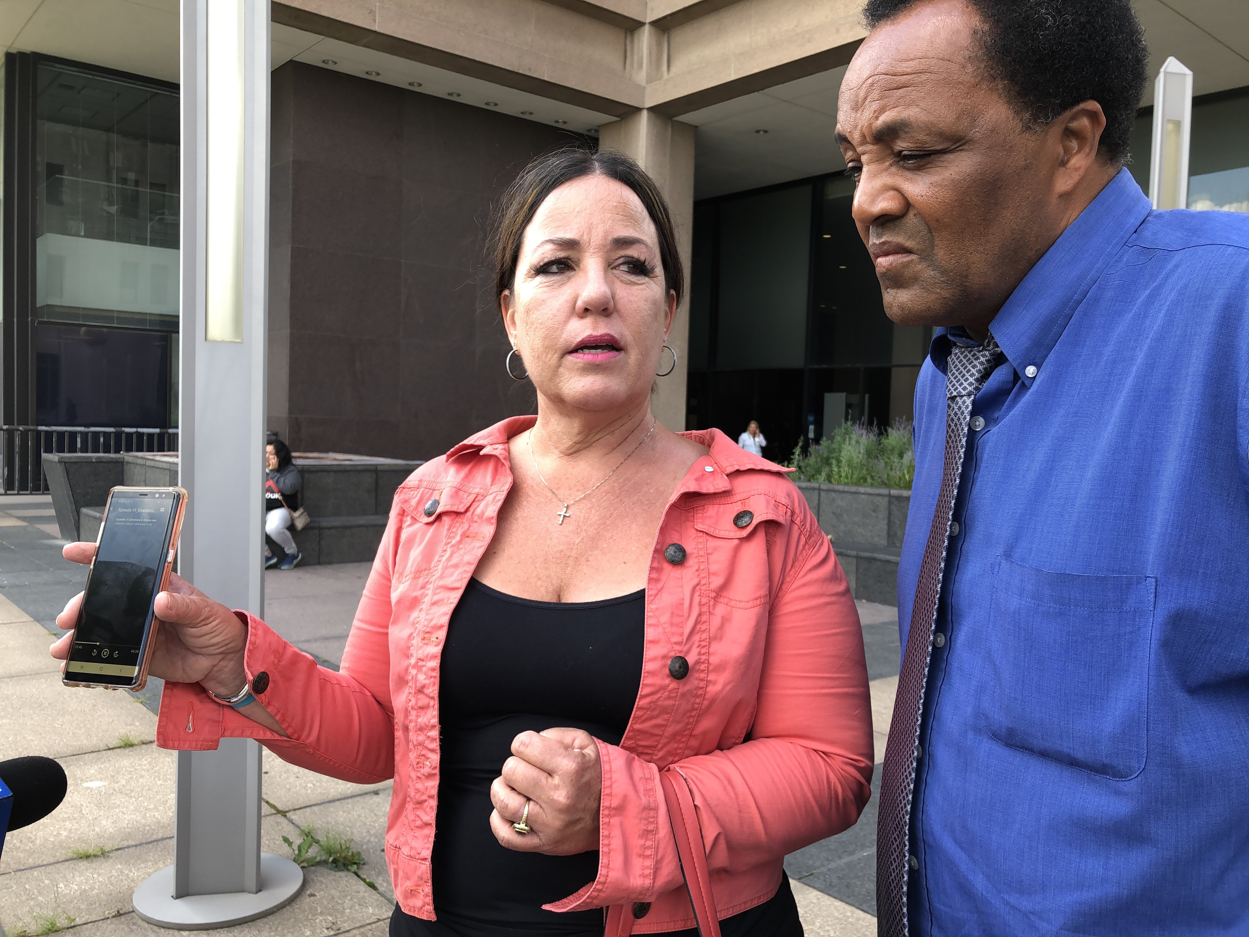 Standing with community activist Andrew Holmes, Tonya Colombo plays a podcast in which  Colombo's son, Shane, had talked about his research. Tonya Colombo flew to Chicago to attend a hearing Tuesday, Aug. 27, 2019, for Diante Speed, who is charged with he