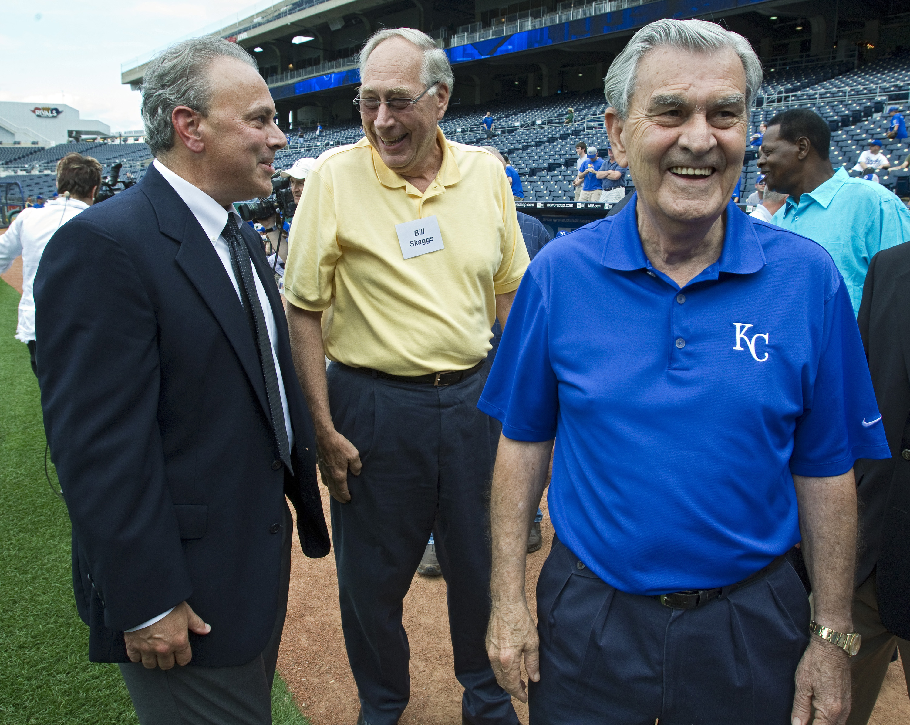 Kansas City Royals owner and CEO David Glass, right, with his son and team president Dan Glass, left, as they visit with Kansas City councilman Bill Skaggs during announcement of the 2012 Major League All-Star Game coming to Kauffman Stadium in Kansas Cit