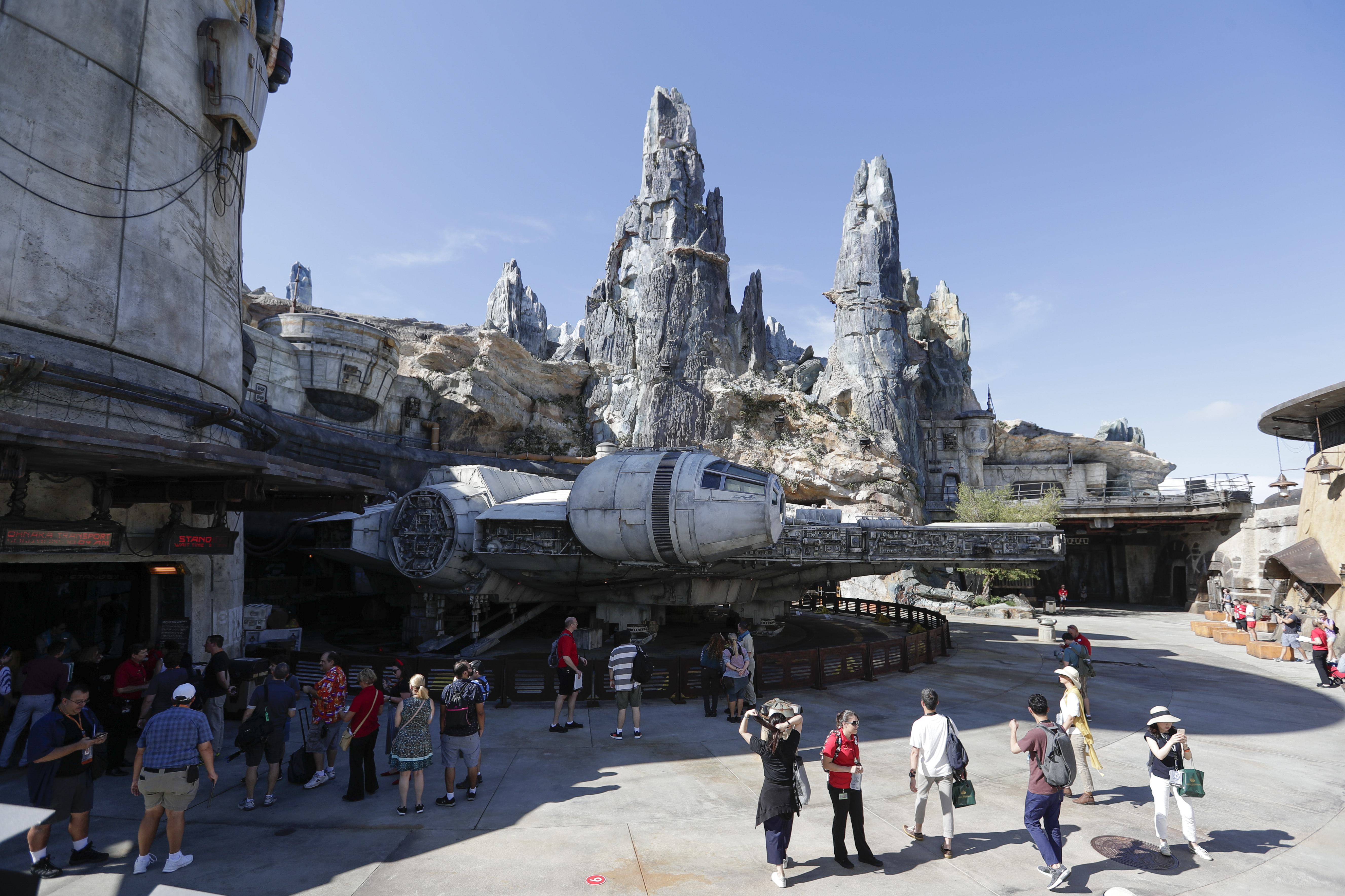 Park visitors walk near the entrance to the Millennium Falcon Smugglers Run ride during a preview of the Star Wars themed land, Galaxy's Edge in Hollywood Studios at Disney World.