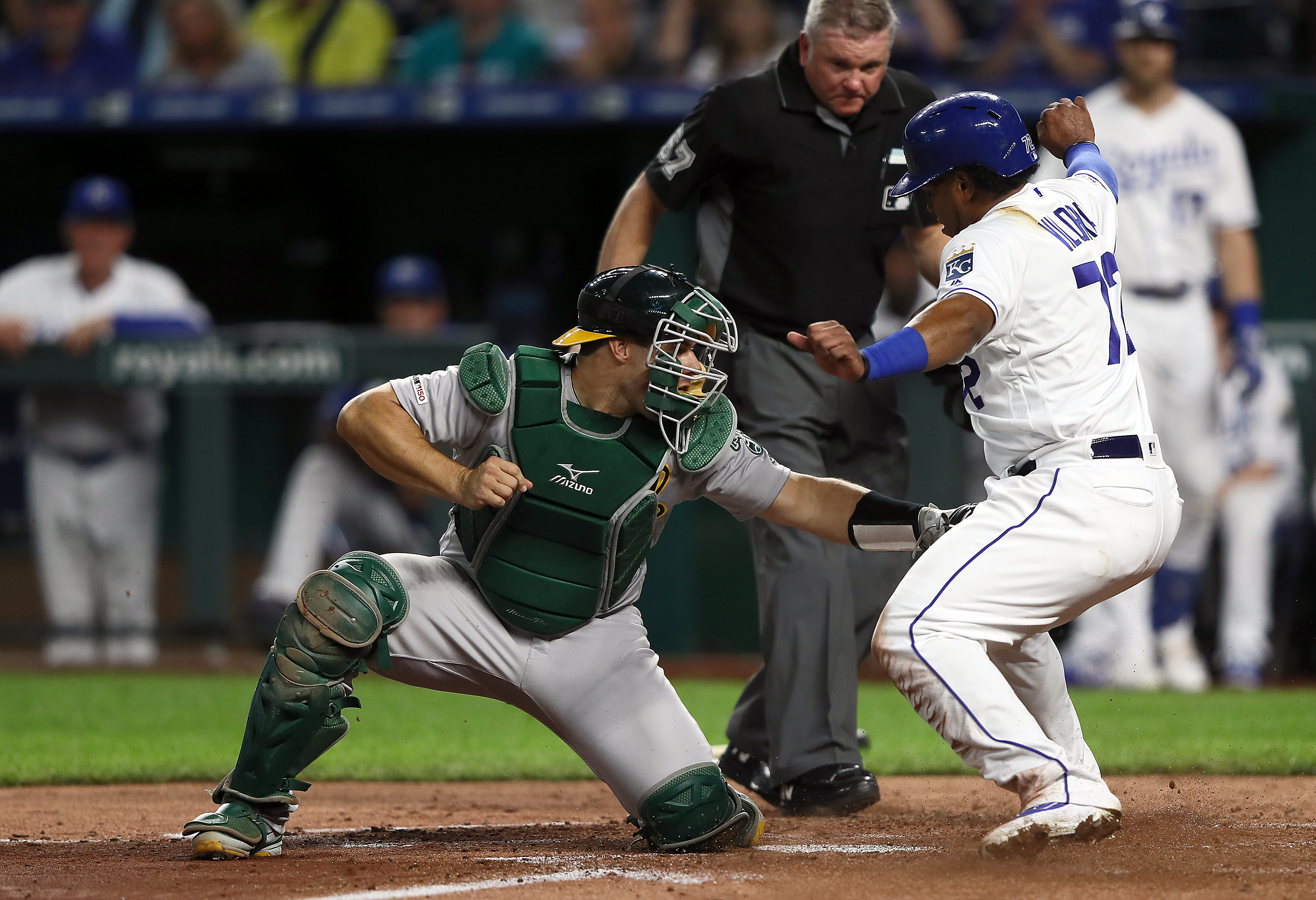 Catcher Josh Phegley #19 of the Oakland Athletics tags out Meibrys Viloria #72 of the Kansas City Royals at home plate during the 3rd inning of the game at Kauffman Stadium on August 27, 2019 in Kansas City, Missouri.