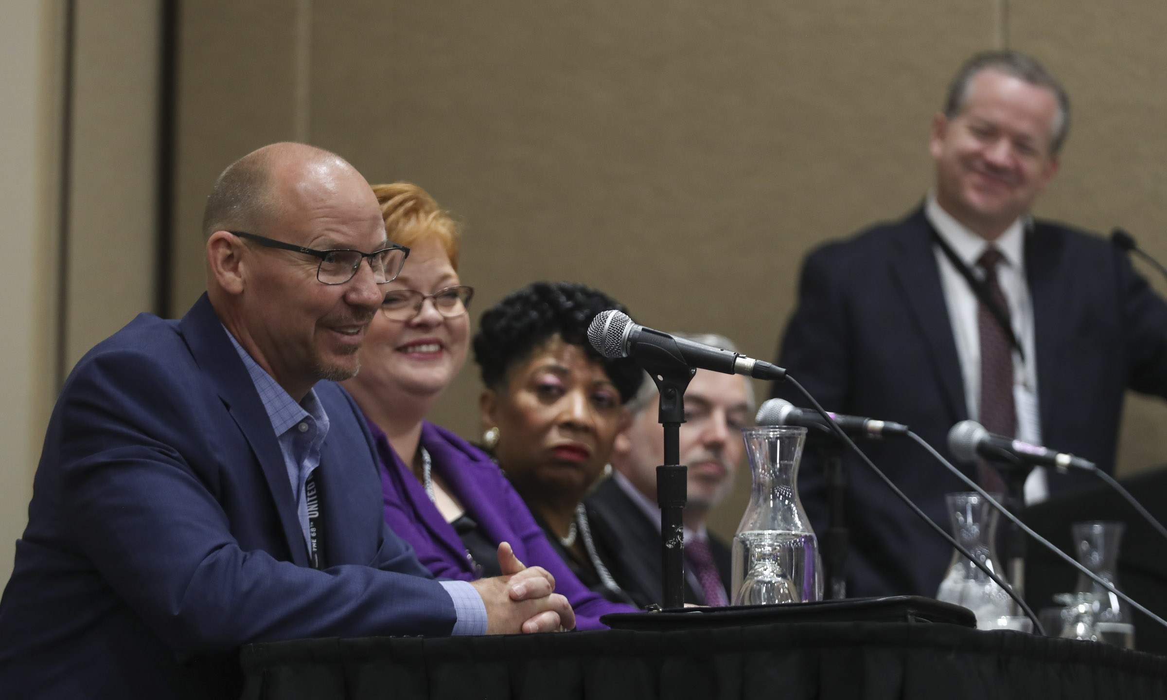 Chris Nelson, manager of The Other Side Academy, left, Kimberly Ishoy, with The Church of Jesus Christ of Latter-day Saints' planning division of welfare and self-reliance services, Jeanetta Williams, president of the NAACP's Salt Lake branch, Scott Winship, executive director of the Joint Economic Committee, and moderator Boyd Matheson, opinion editor for the Deseret News, take park in the Interfaith Dialogue at the 68th United Nations Civil Society Conference at the Salt Palace Convention Center in Salt Lake City on Tuesday, Aug. 27, 2019.