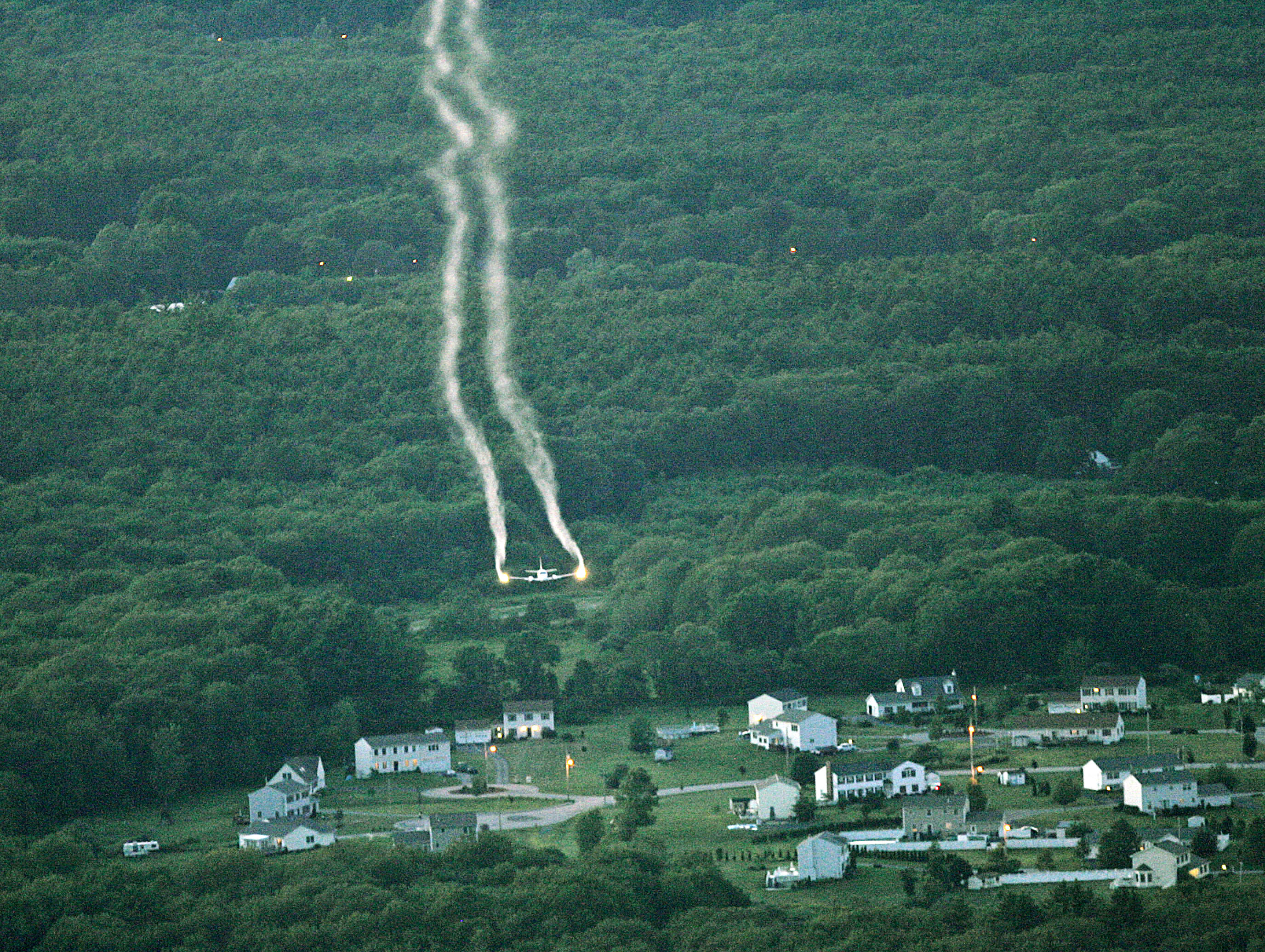 A plane spraying mosquito killer on a forest in southeastern Massachusetts.