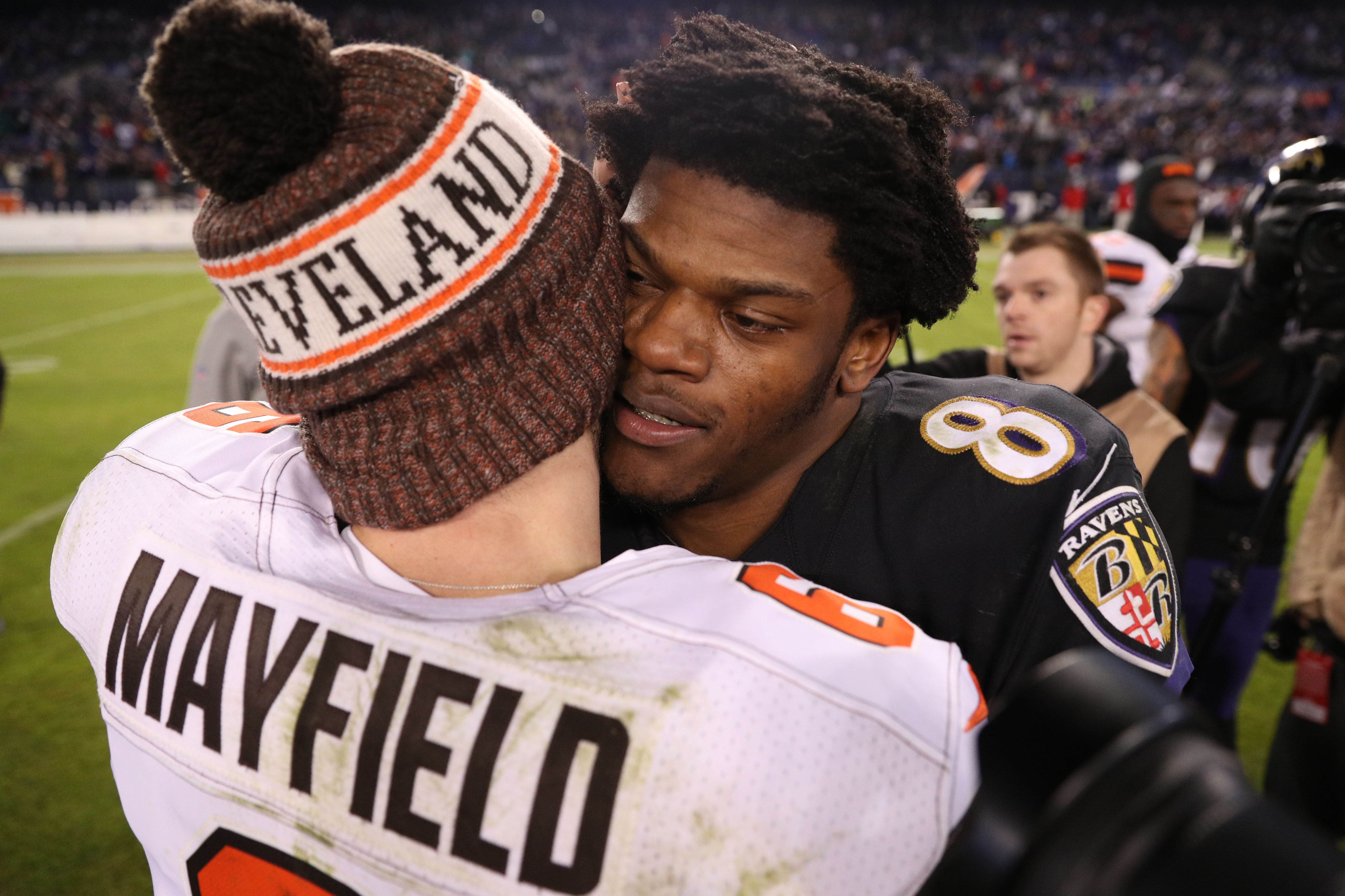 Quarterback Lamar Jackson of the Baltimore Ravens hugs quarterback Baker Mayfield of the Cleveland Browns after the Baltimore Ravens 26-24 win over Cleveland Browns at M&T Bank Stadium on December 30, 2018 in Baltimore, Maryland.