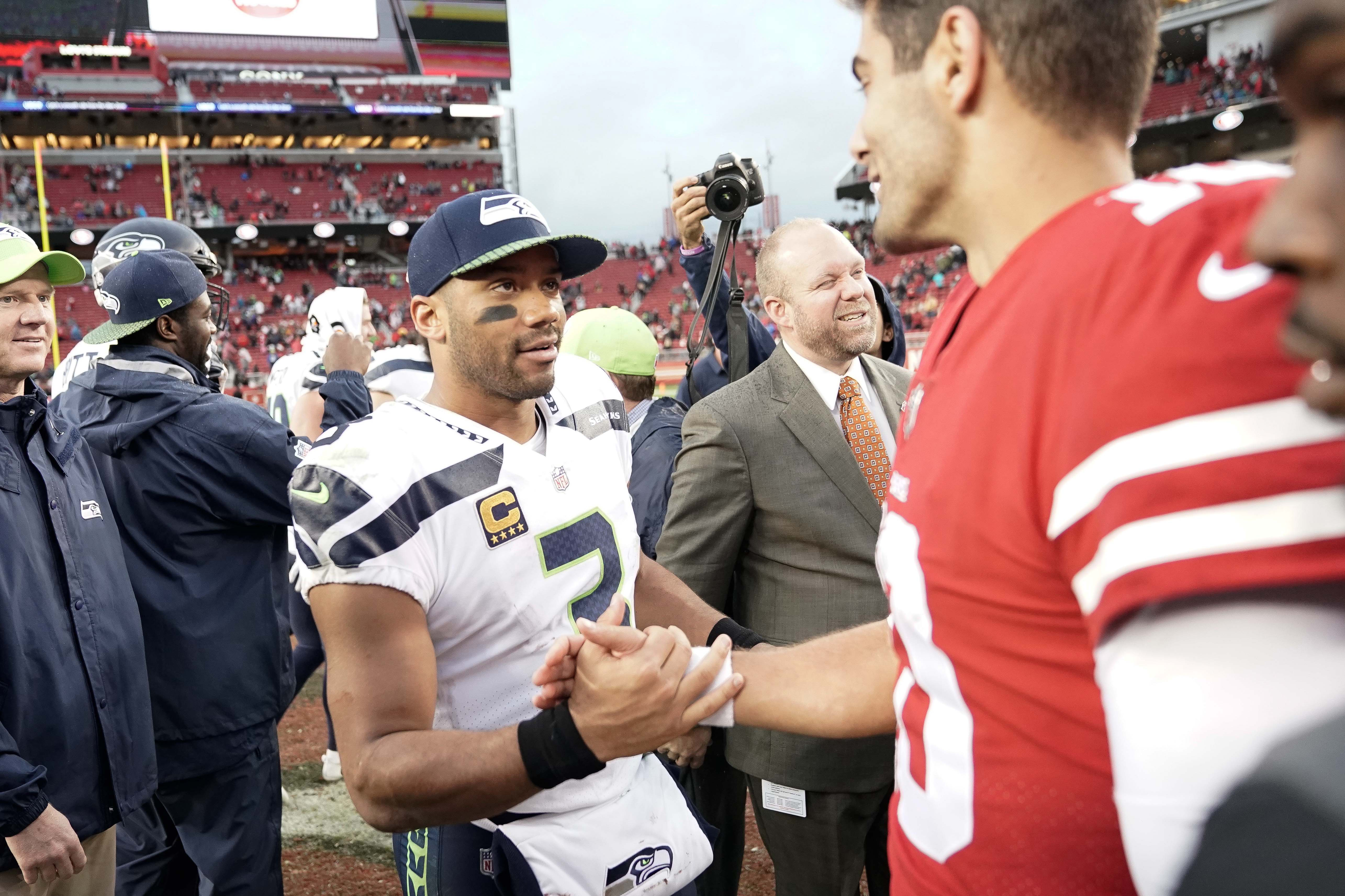 Seattle Seahawks quarterback Russell Wilson shakes hands with San Francisco 49ers quarterback Jimmy Garoppolo after the Seahawks win at Levi's Stadium in Santa Clara, California.