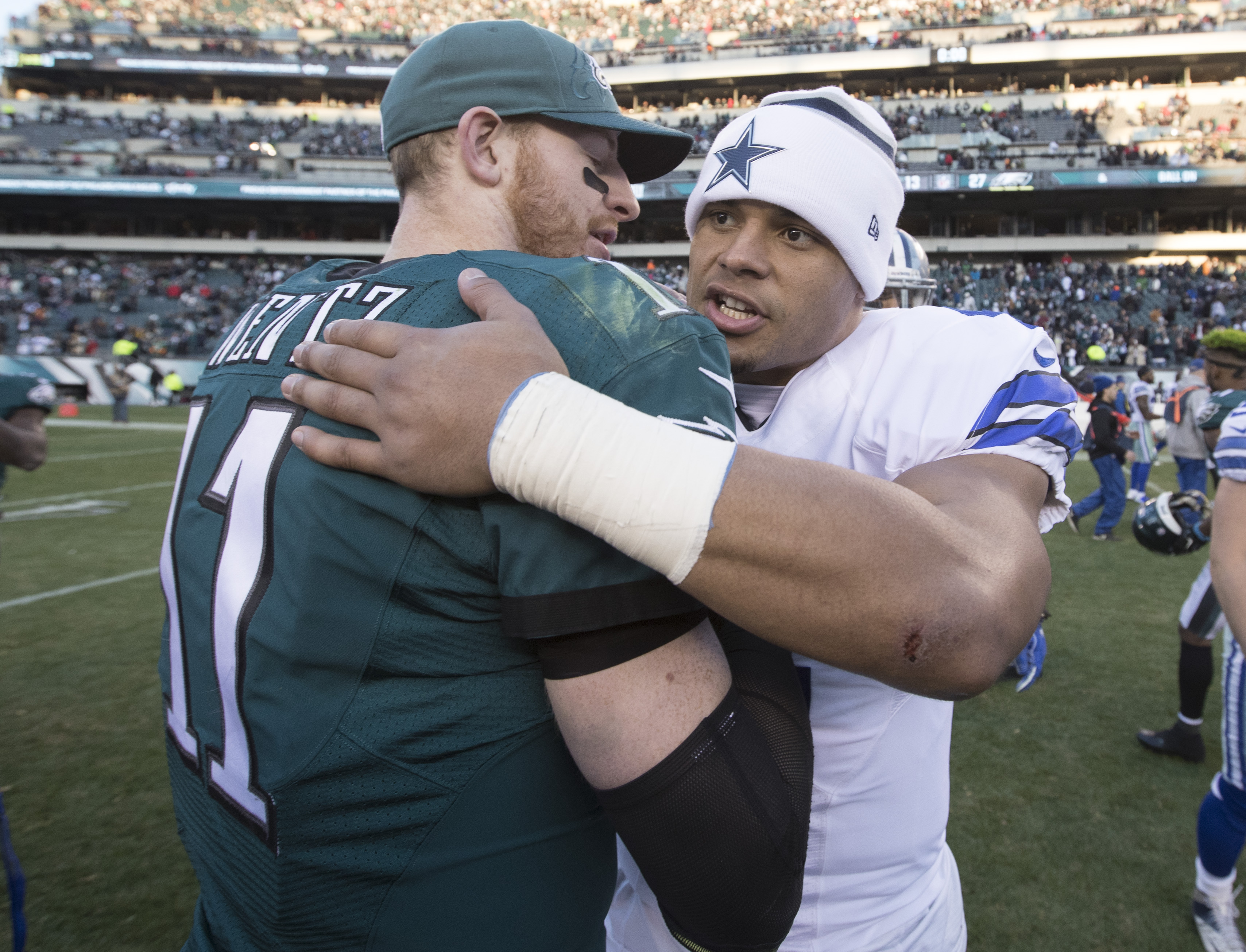 Quarterback Carson Wentz of the Philadelphia Eagles hugs Dak Prescott of the Dallas Cowboys after the game at Lincoln Financial Field on January 1, 2017 in Philadelphia, Pennsylvania. The Eagles defeated the Cowboys 27-13.