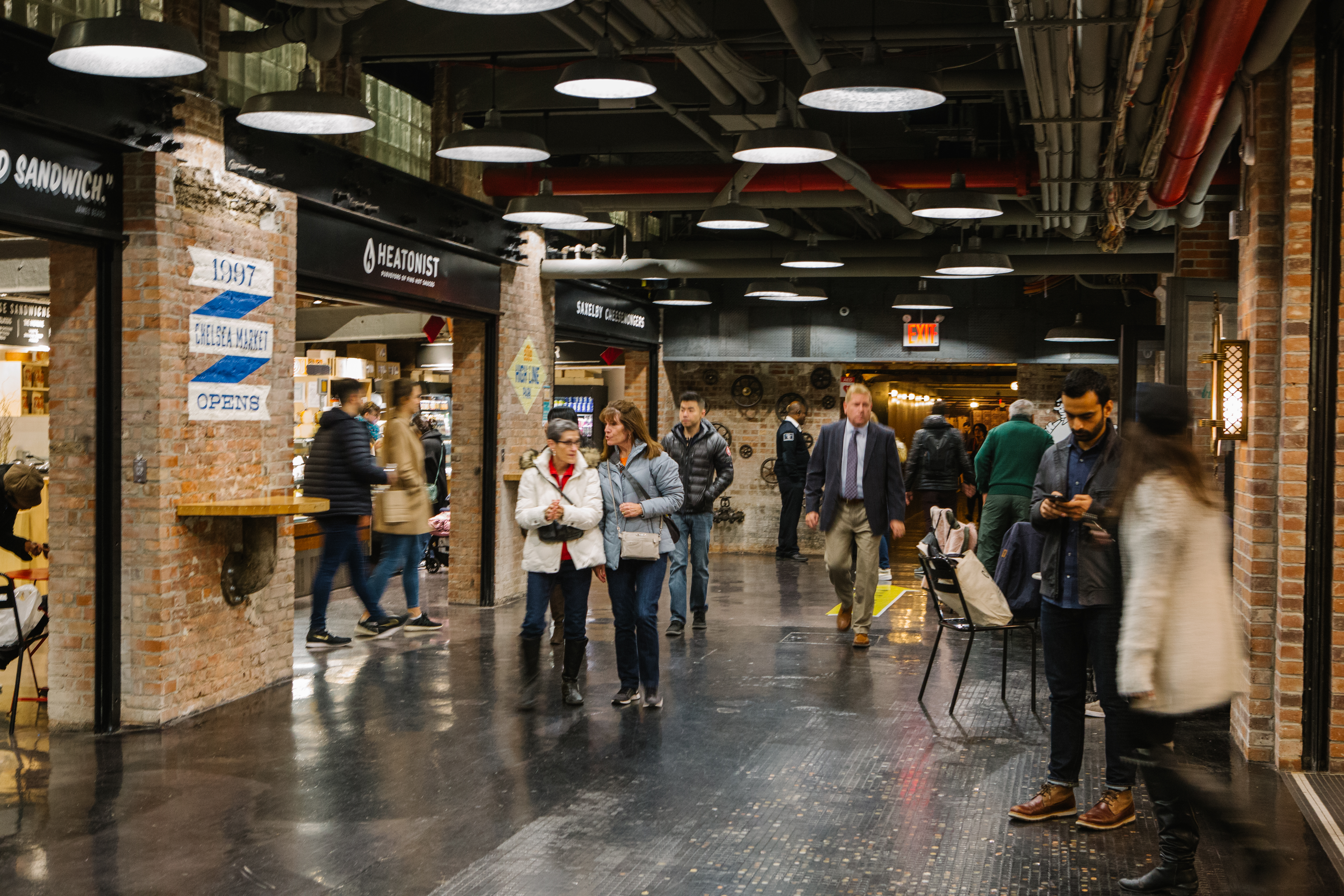 People walking through the downstairs area of Chelsea Market