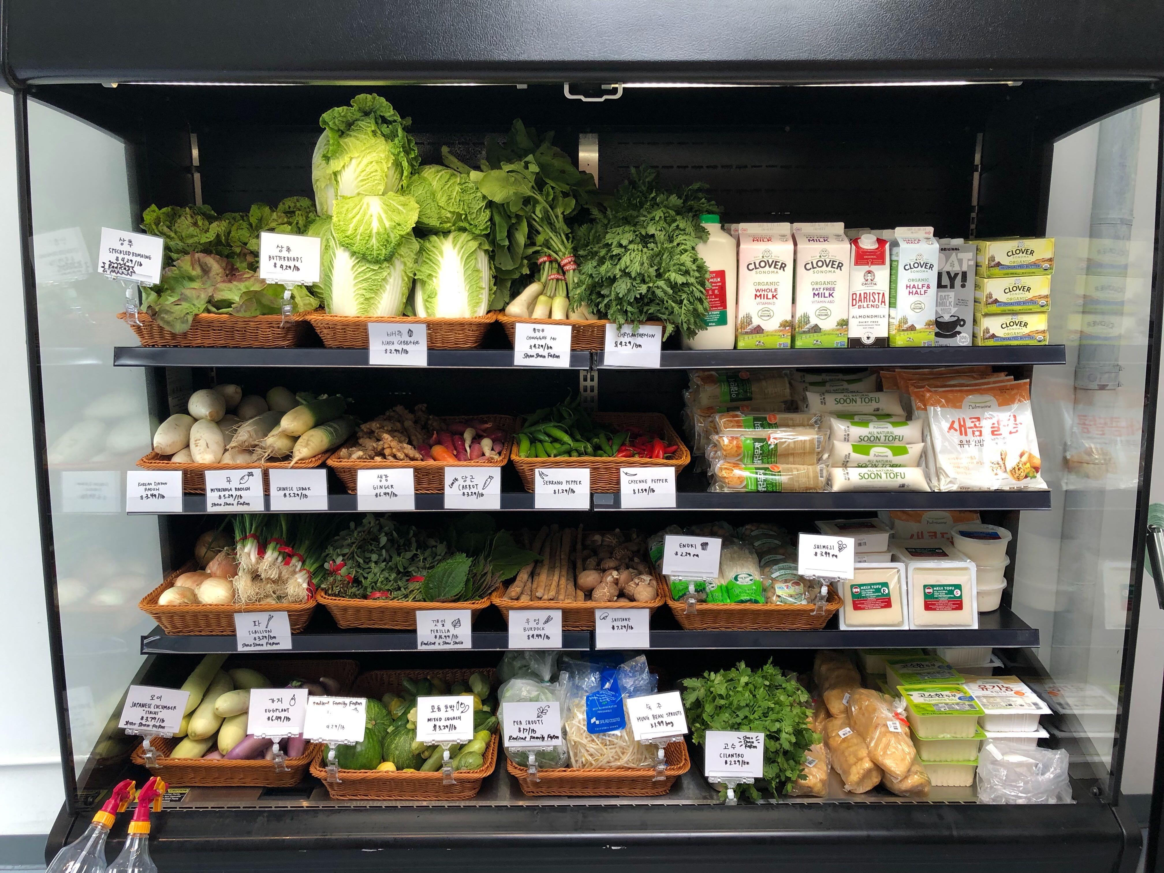 A shelf of produce at a market