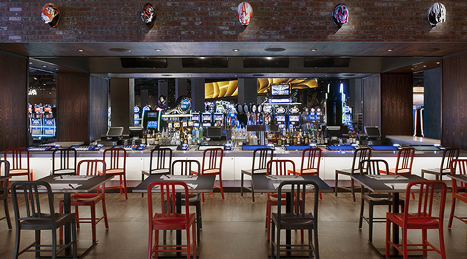 The new sport bar and burger restaurant features a large bar, TVs playing sports and a casual setting.