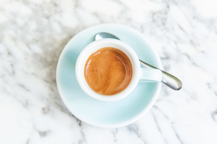 Espresso on a marble background at one of London's best coffee shops, Milk Beach