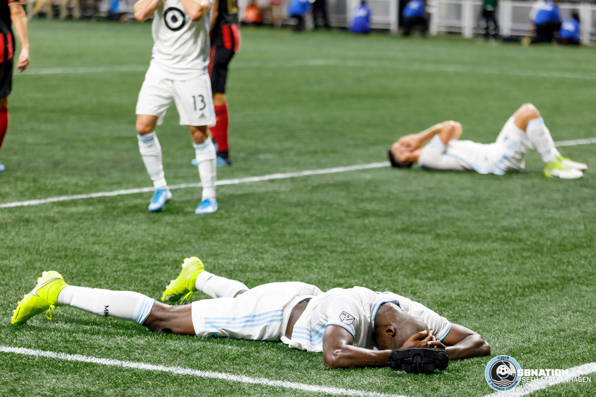 August 27, 2019 - Atlanta, Georgia, United States - Minnesota United defender Ike Opara (3) and fellow defender Michael Boxall (15) lay on the turf in disappointment after a missed goal scoring opportunity during the US Open Cup Final match between Atlanta United and Minnesota United at Mercedes-Benz Stadium.