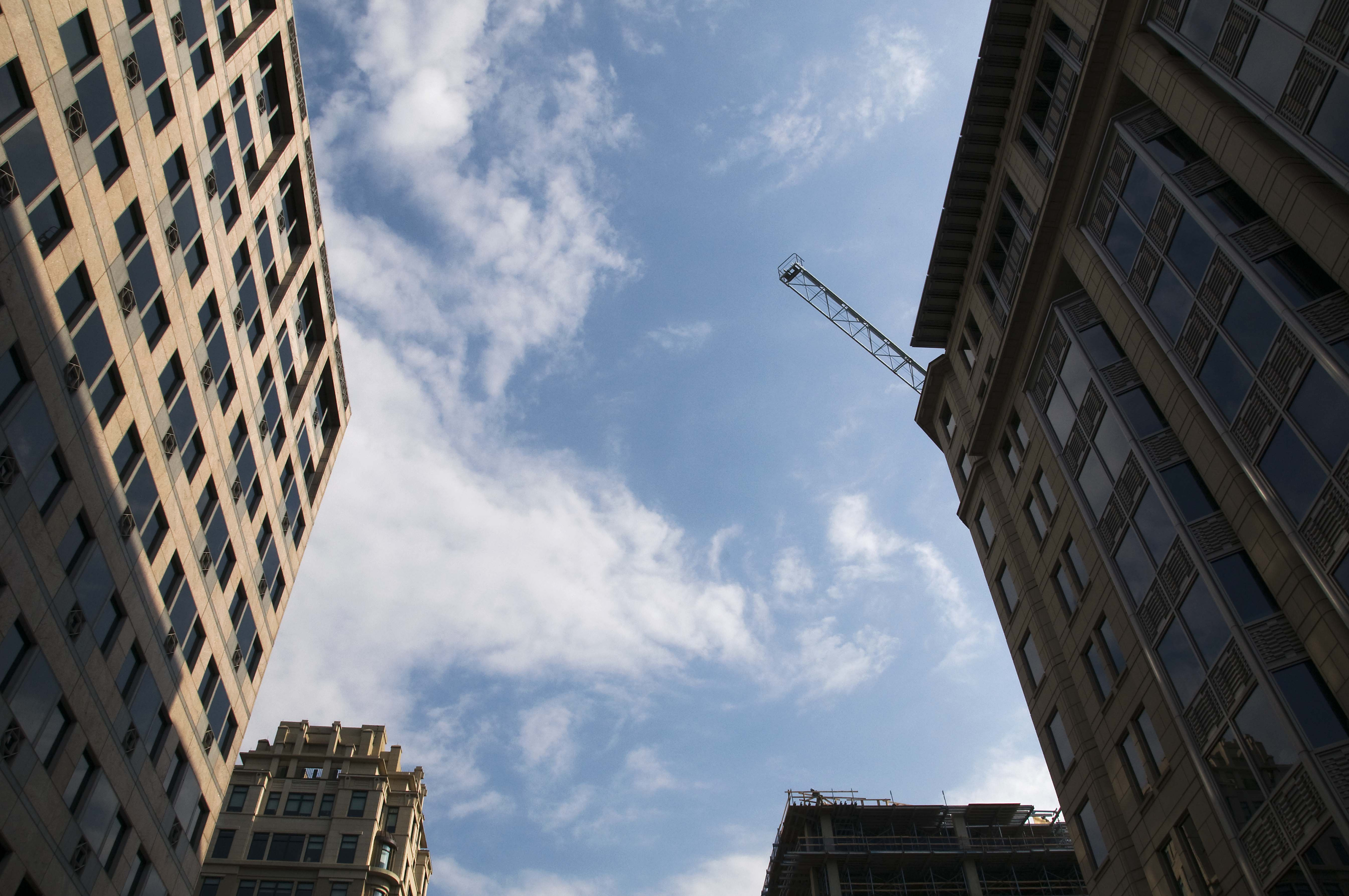 A sky shot of buildings in Washington, D.C. A crane is seen above one of the buildings.