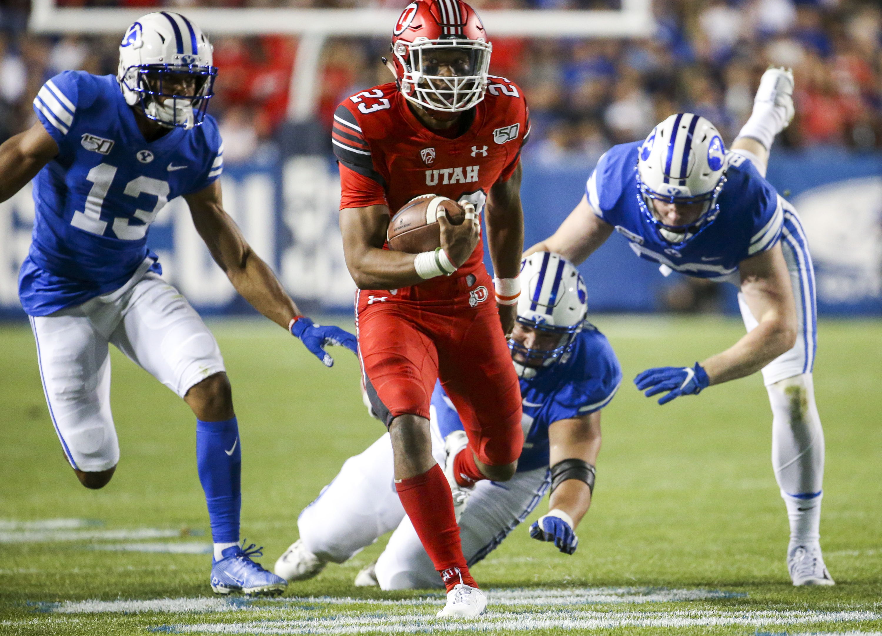 Utah defensive back Julian Blackmon (23) runs an interception back for a touchdown during the second half of the Utah-BYU football game at LaVell Edwards Stadium in Provo on Thursday, Aug. 29, 2019.