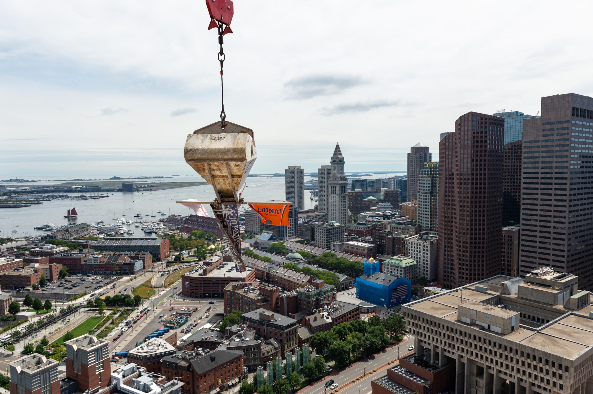 A crane suspended over Boston.
