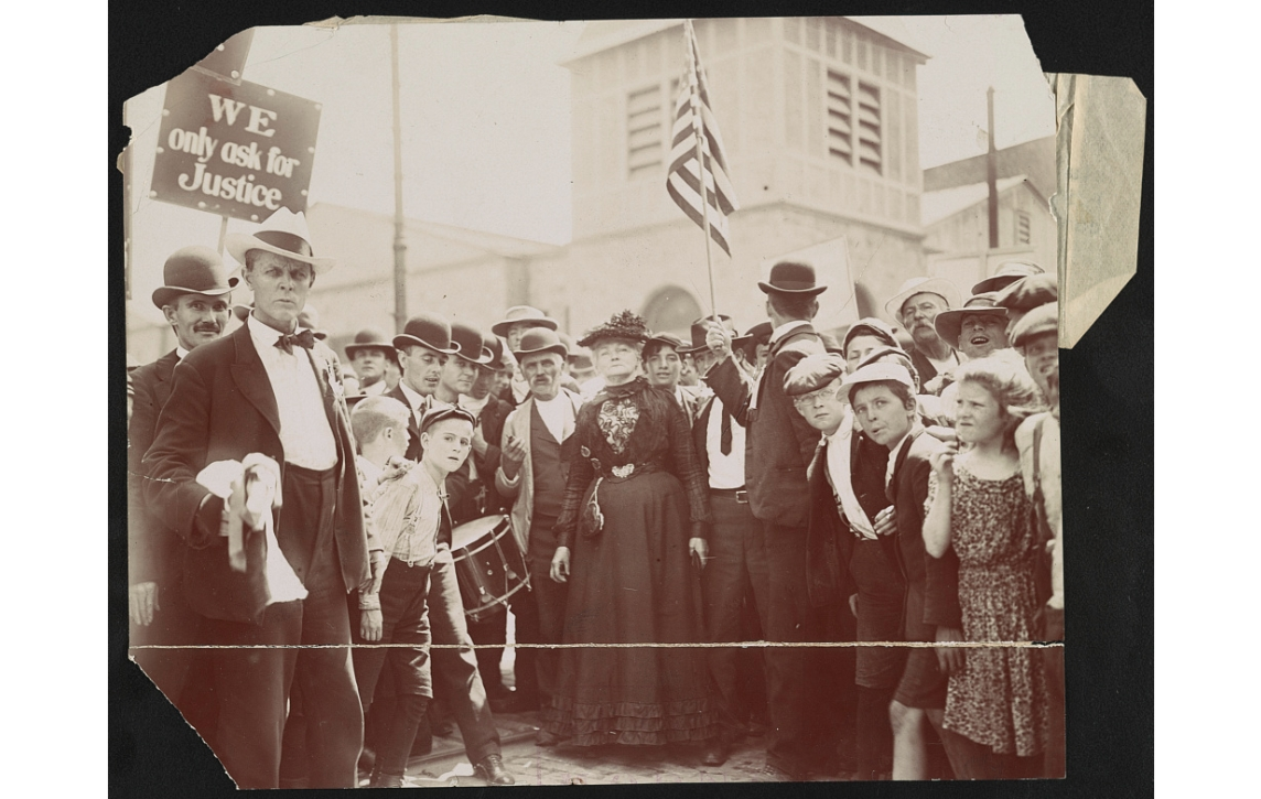 A 1909 photo of striking textile workers featuring Mother Jones.
