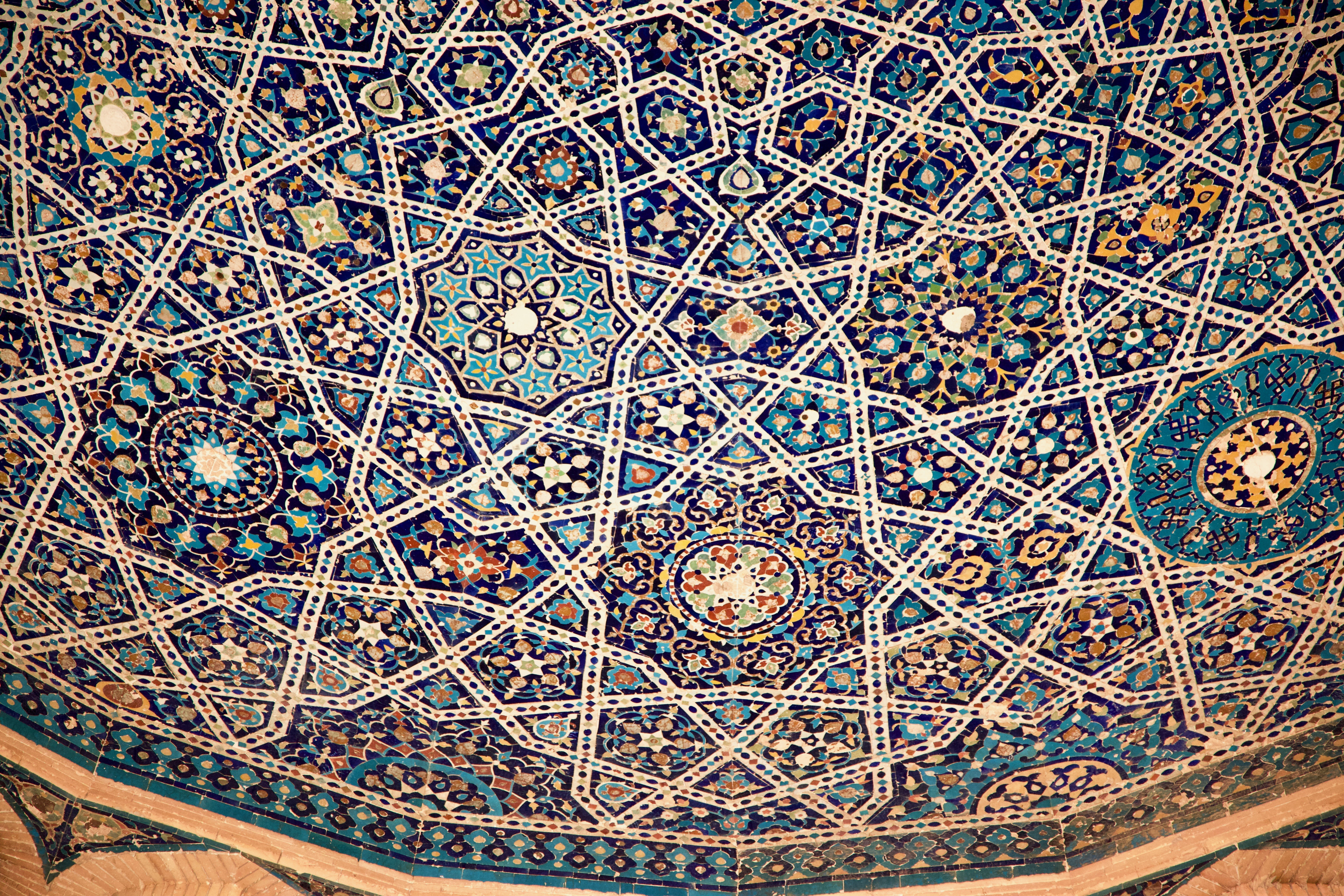 Geometric tile patterns from the dome of a Muslim tomb.