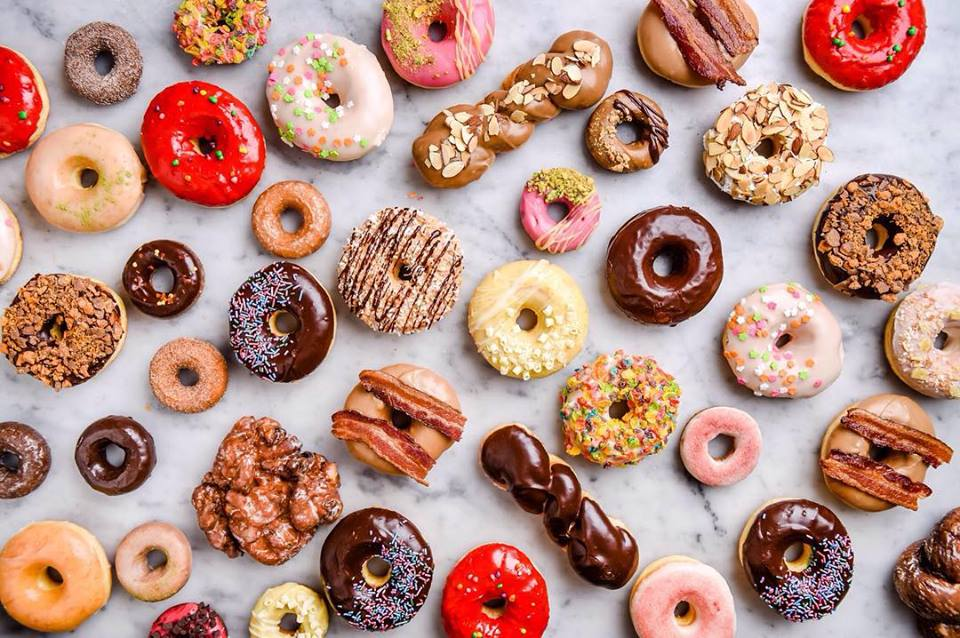 A wide selection of every kind and shape of doughnut