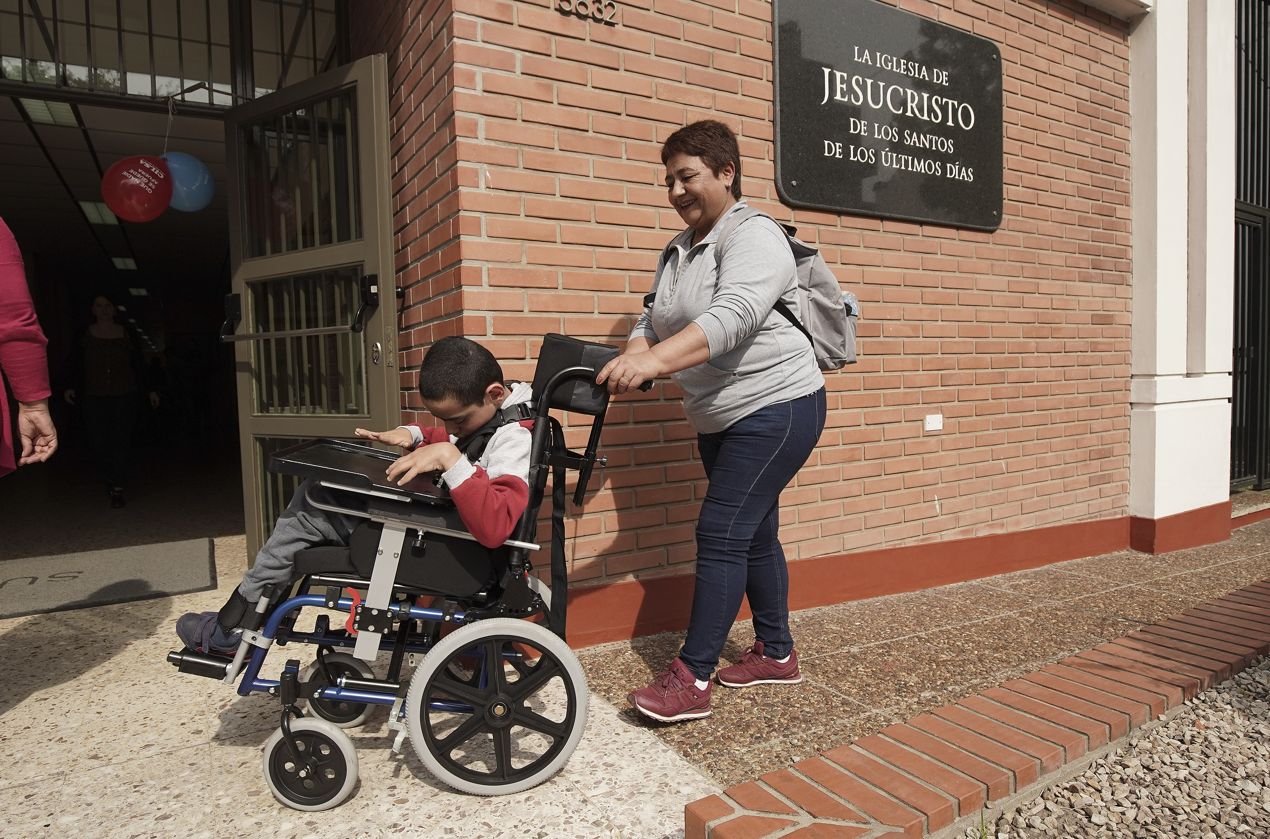 Norma Arguello pushes her son Nahuel in his new wheelchair as Latter-day Saint Charities donated wheelchairs to recipients at the Villa Urquiza Ward in Buenos Aires, Argentina on Wednesday, Aug. 28, 2019.