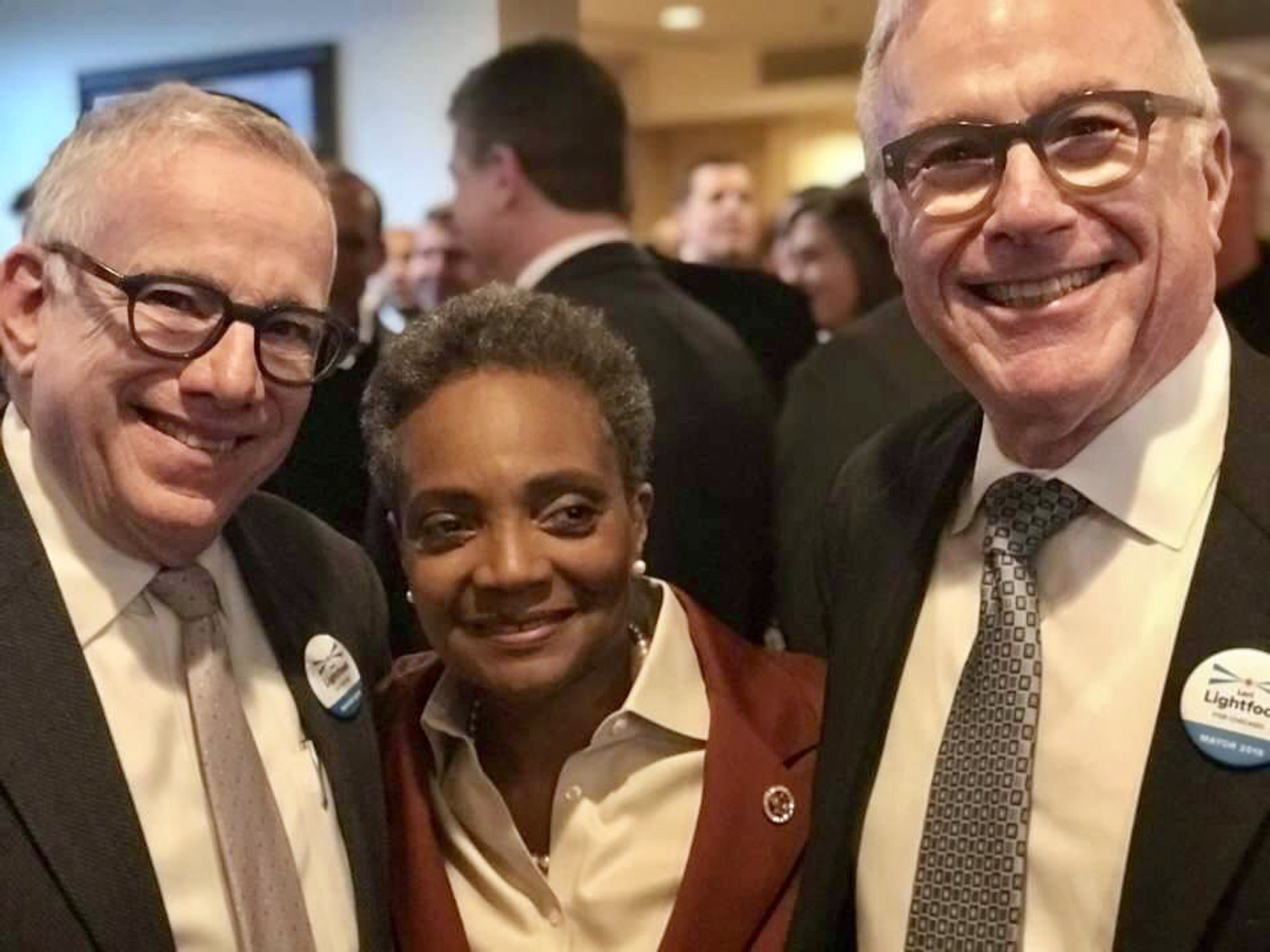 Michael Bauer (right) with Mayor Lori Lightfoot and his husband, Roger Simon. Bauer chaired Lightfoot's campaign for mayor.