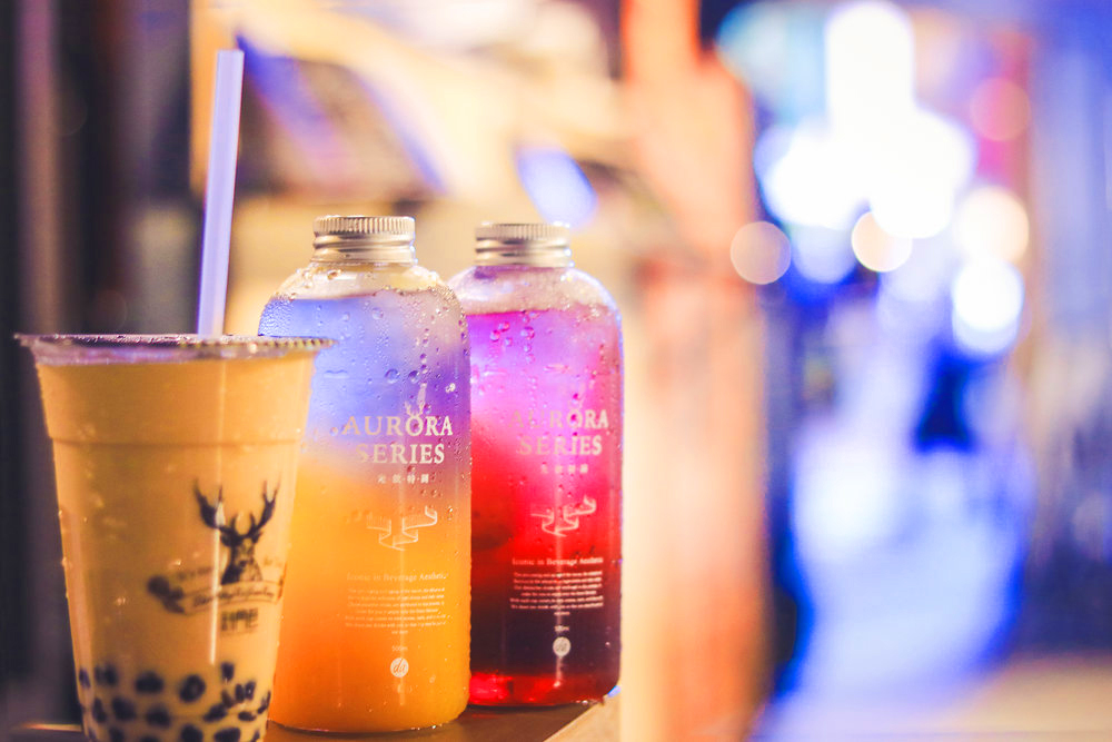 Three brightly colored Taiwanese-style teas, the signature look of new beverage franchise The Alley.