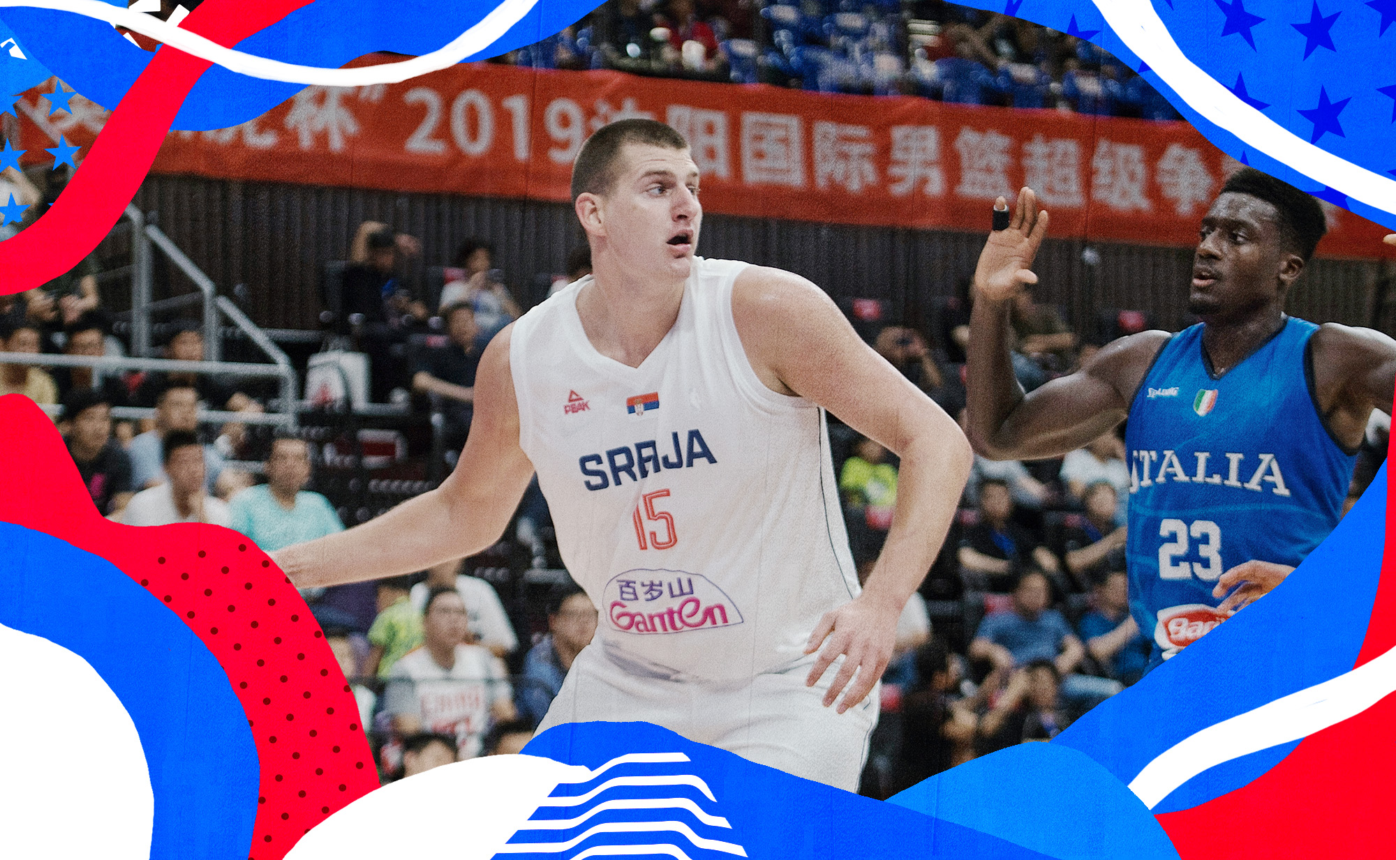 Serbia's Nikola Jokic, controlling the ball with his right hand, attempts to make a move in front of Italy's Awudu Abass.