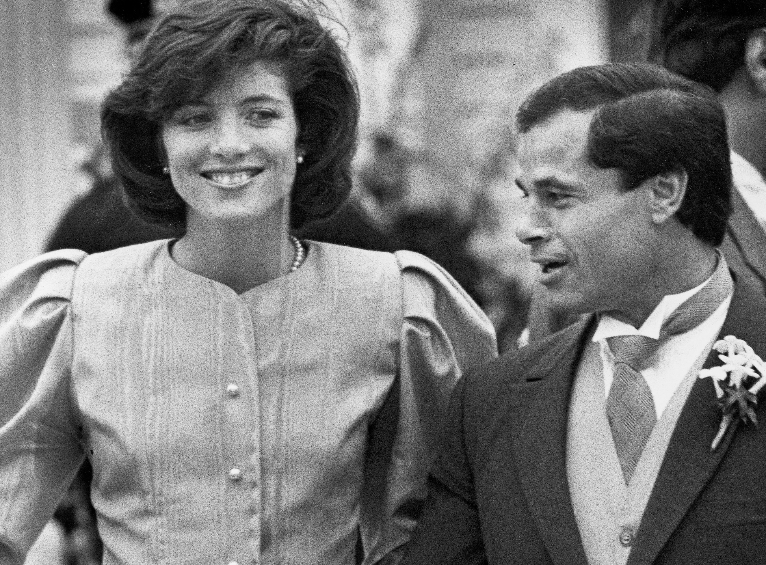 Maid of honor Caroline Kennedy and Best Man Franco Columbu, leave St. Francis Xavier Church after the wedding of Caroline's cousin Maria Shriver to Arnold Schwarzenegger in Hyannis, Massachusetts in 1986.