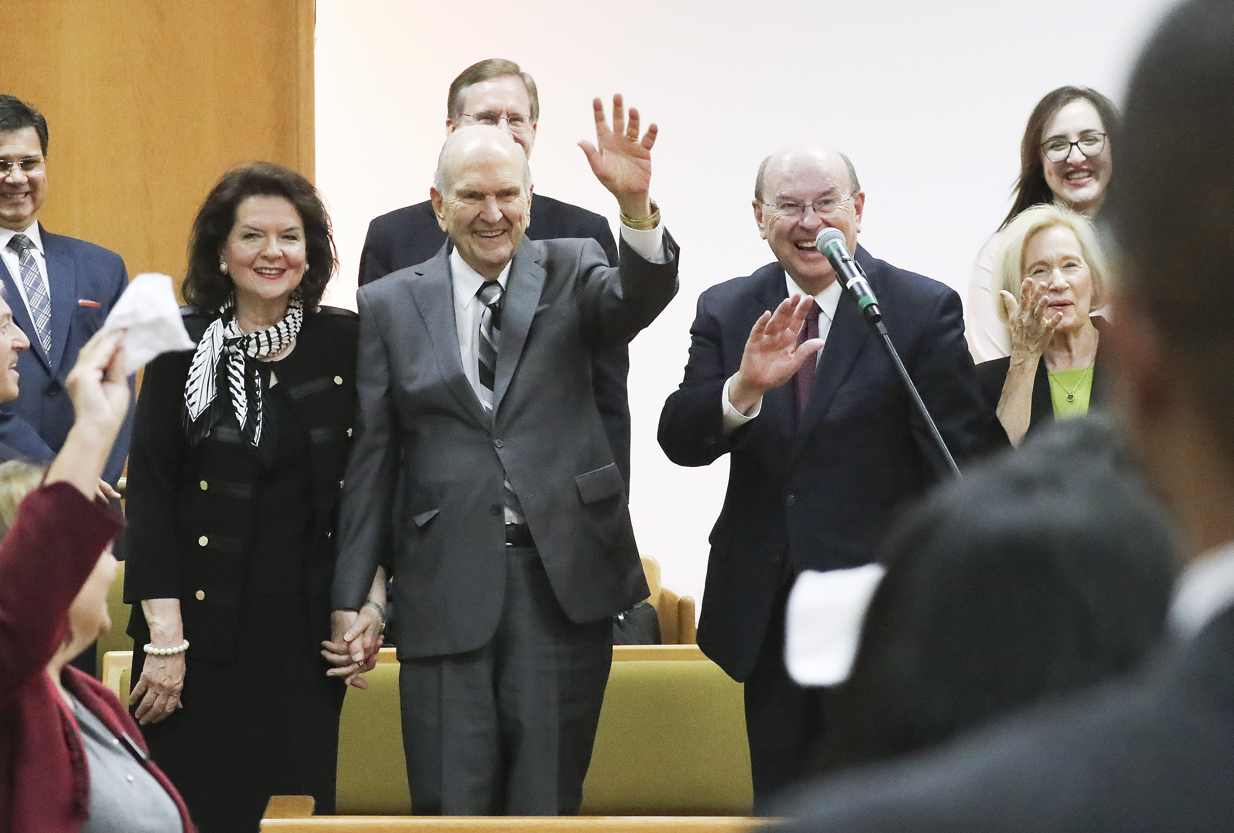 President Russell M. Nelson of The Church of Jesus Christ of Latter-day Saints and his wife Sister Wendy Nelson with Elder Quentin L. Cook, Quorum of the Twelve Apostles, and his wife Sister Mary Cook wave to missionaries after speaking during a Brasilia Mission meeting in Brasilia, Brazil on Friday, Aug. 30, 2019.