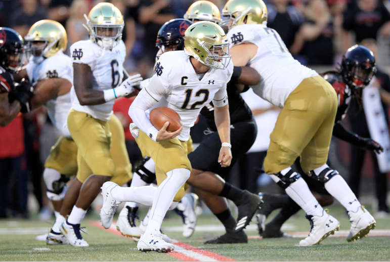Notre Dame quarterback Ian Book ran for one touchdown and threw for another in Monday's win against Louisville.