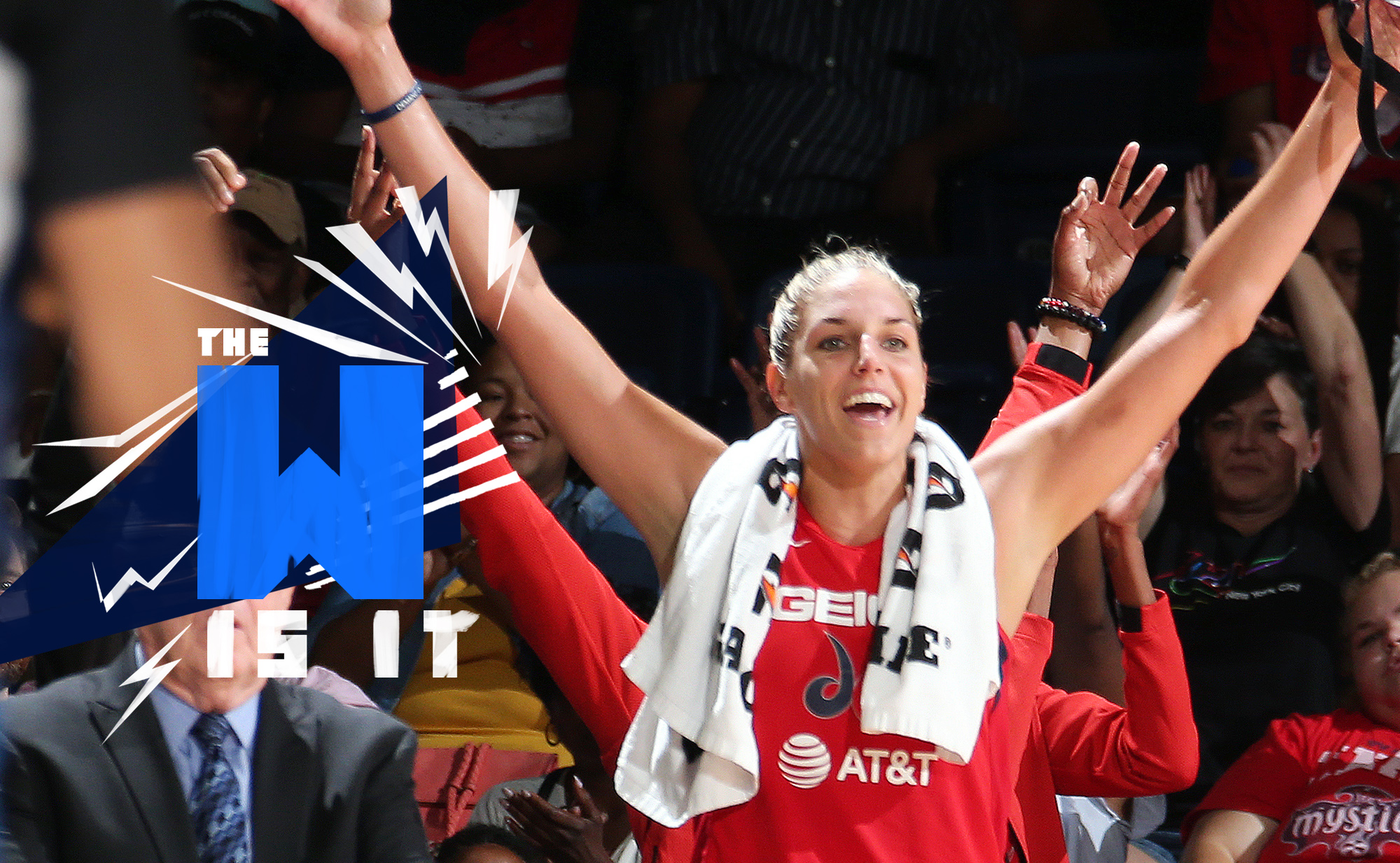 Elena Delle Donne of the Washington Mystics raises her arms above her head in reaction to a play on the court.