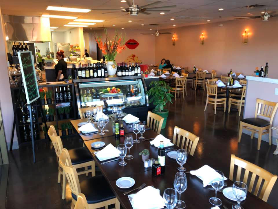 The causal seating area and open kitchen at chef Piero Broglia's new Italian restaurant in Henderson.