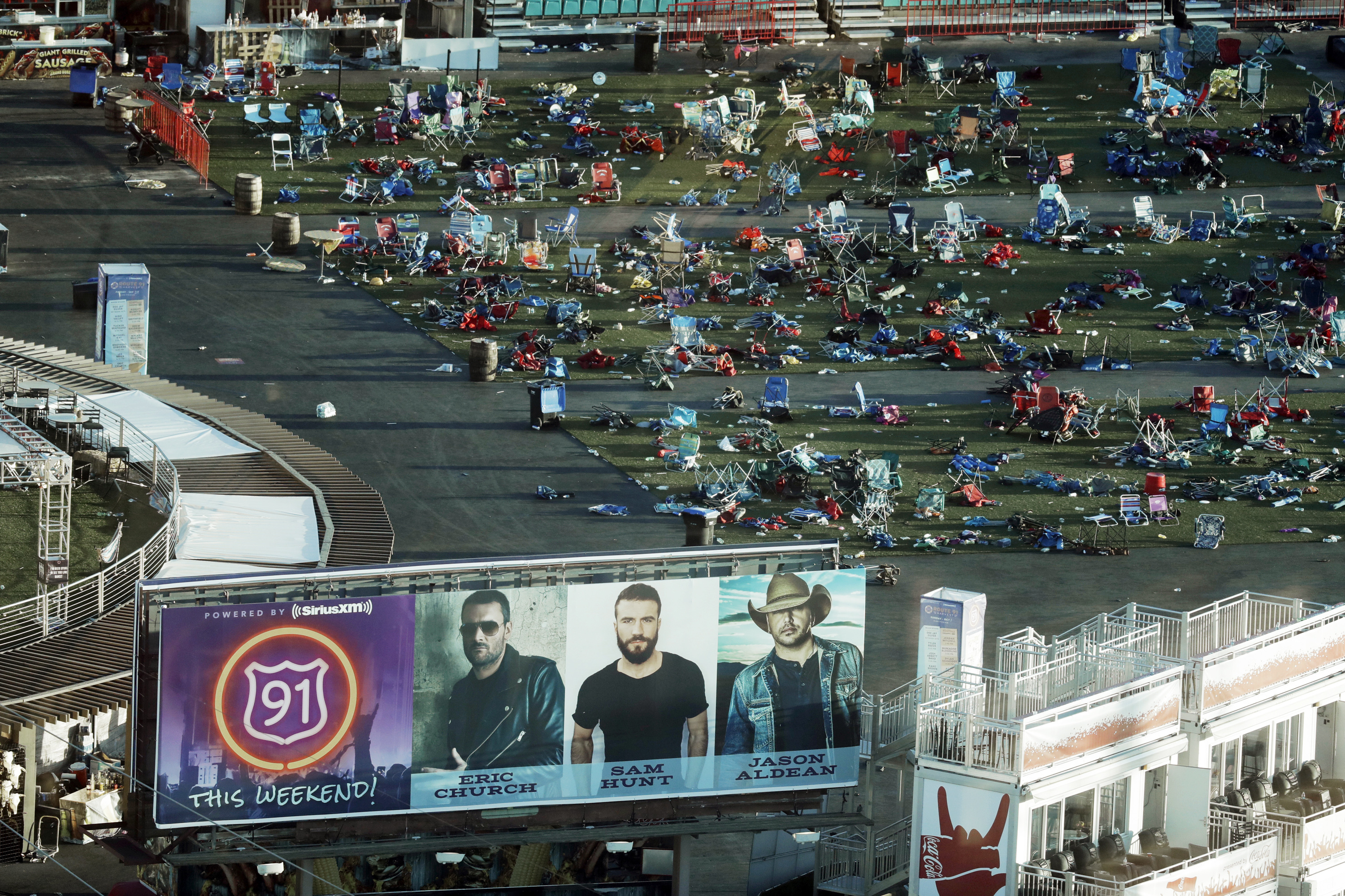In this Oct. 3, 2017 file photo, personal belongings and debris litters the Route 91 Harvest festival grounds across the street from the Mandalay Bay resort and casino in Las Vegas.