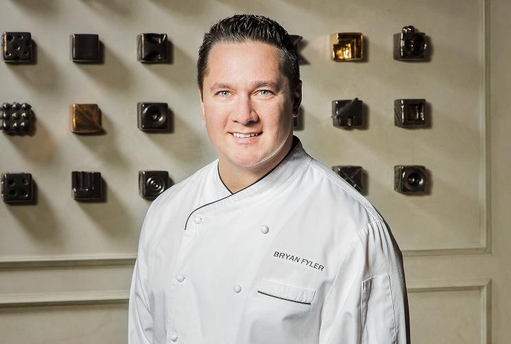 Bryan Fyler wearing a white chef coat