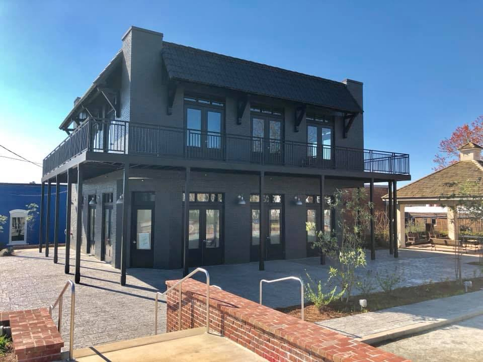 A two-story, dark gray building in Duluth's Parsons Alley development will be home to Sweet Octopus