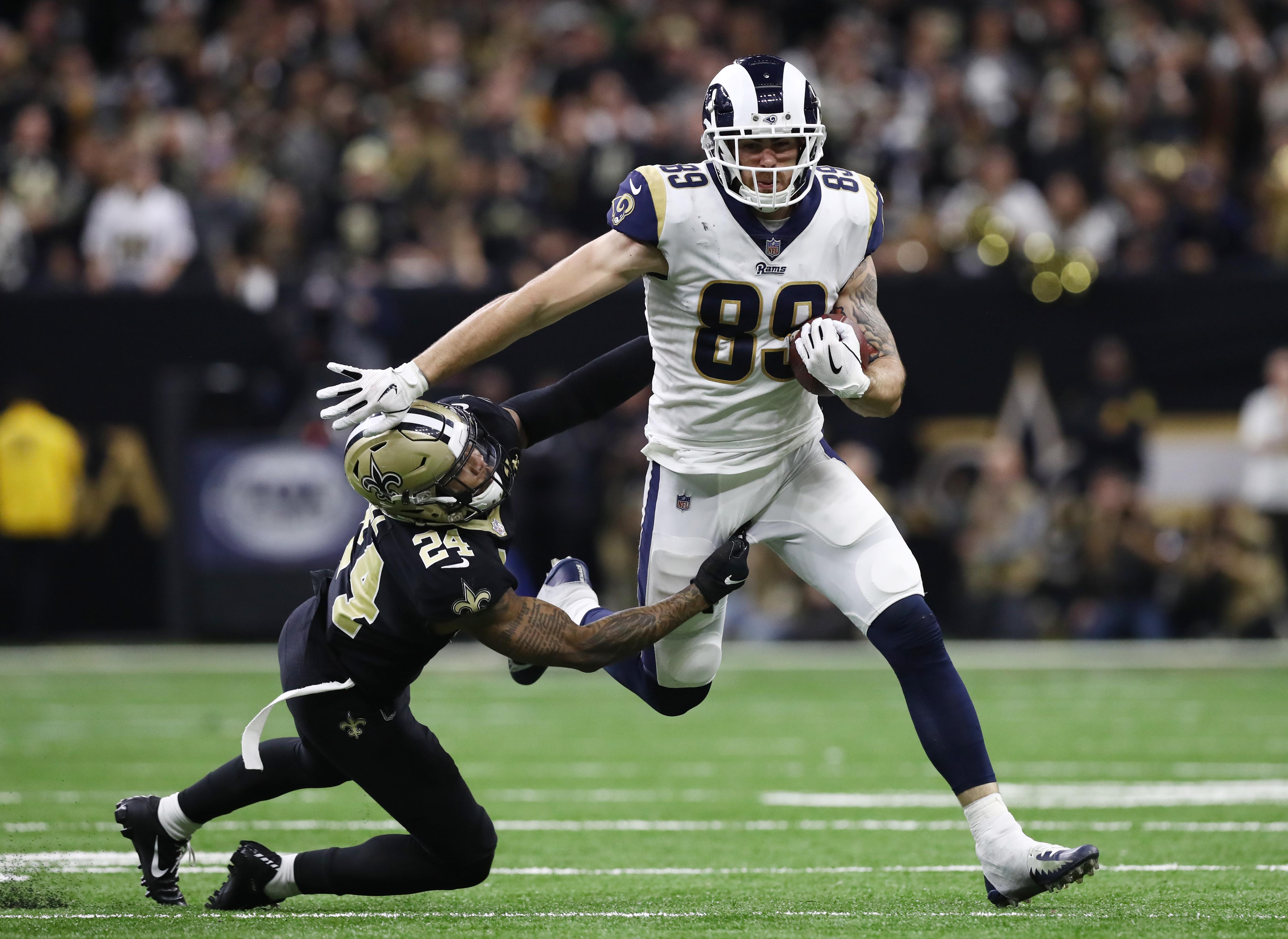Los Angeles Rams TE Tyler Higbee gets away from New Orleans Saints S Vonn Bell during overtime in the NFC Championship, Jan. 20, 2019.