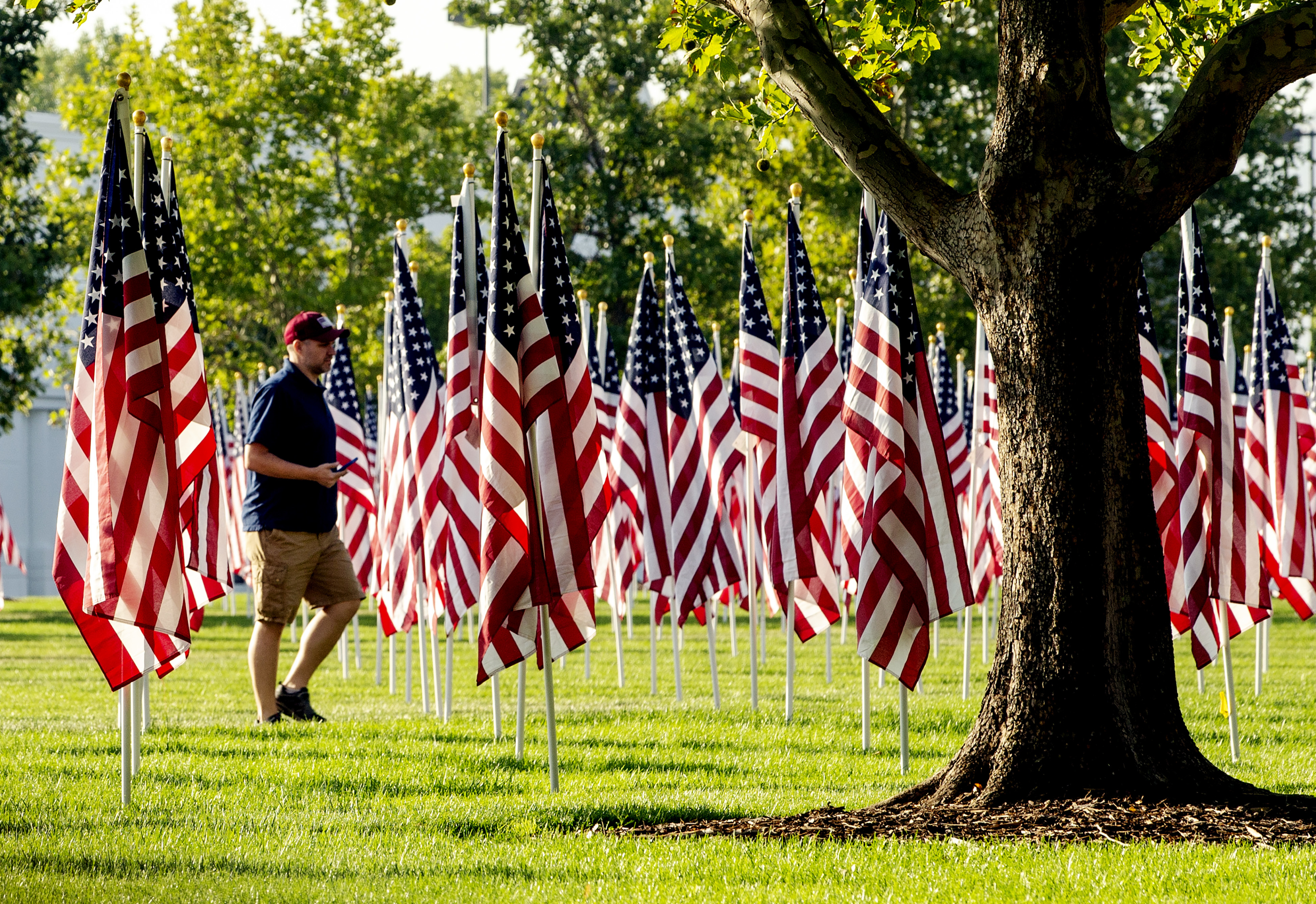 Jason Both, of Lehi, looks for a spot to take a photo as he visits the Utah Healing Field outside Sandy City Hall on Monday, Sept. 10, 2018. The massive display, a tradition since 2002, features 3,000 American flags in honor the victims of the terrorist a