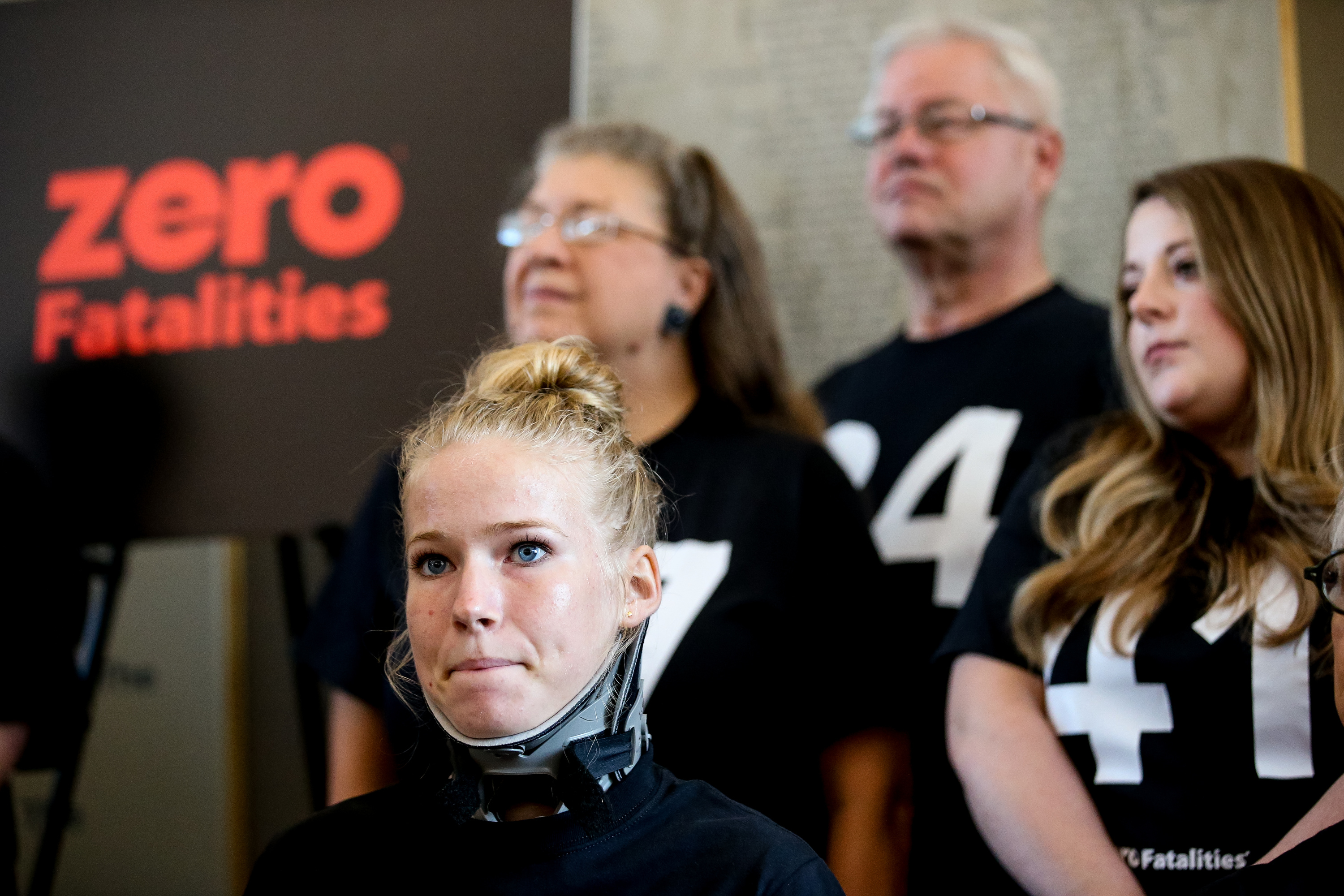 Meghan Hunter, 18, of Provo, left, listens during a press conference reporting the sharpest-ever decrease in the number of road fatalities during the summer at Intermountain Medical Center in Murray on Thursday, Sept. 5, 2019. Hunter and her brother were involved in a July 4 rollover accident that fractured several of her vertebrae, but she credited the facts that they weren't speeding and were wearing seat belts with saving their lives. At the press conference, people in numbered shirts represented the 41 fewer road fatalities Utah experienced during the period between Memorial Day and Labor Day compared to 2018.