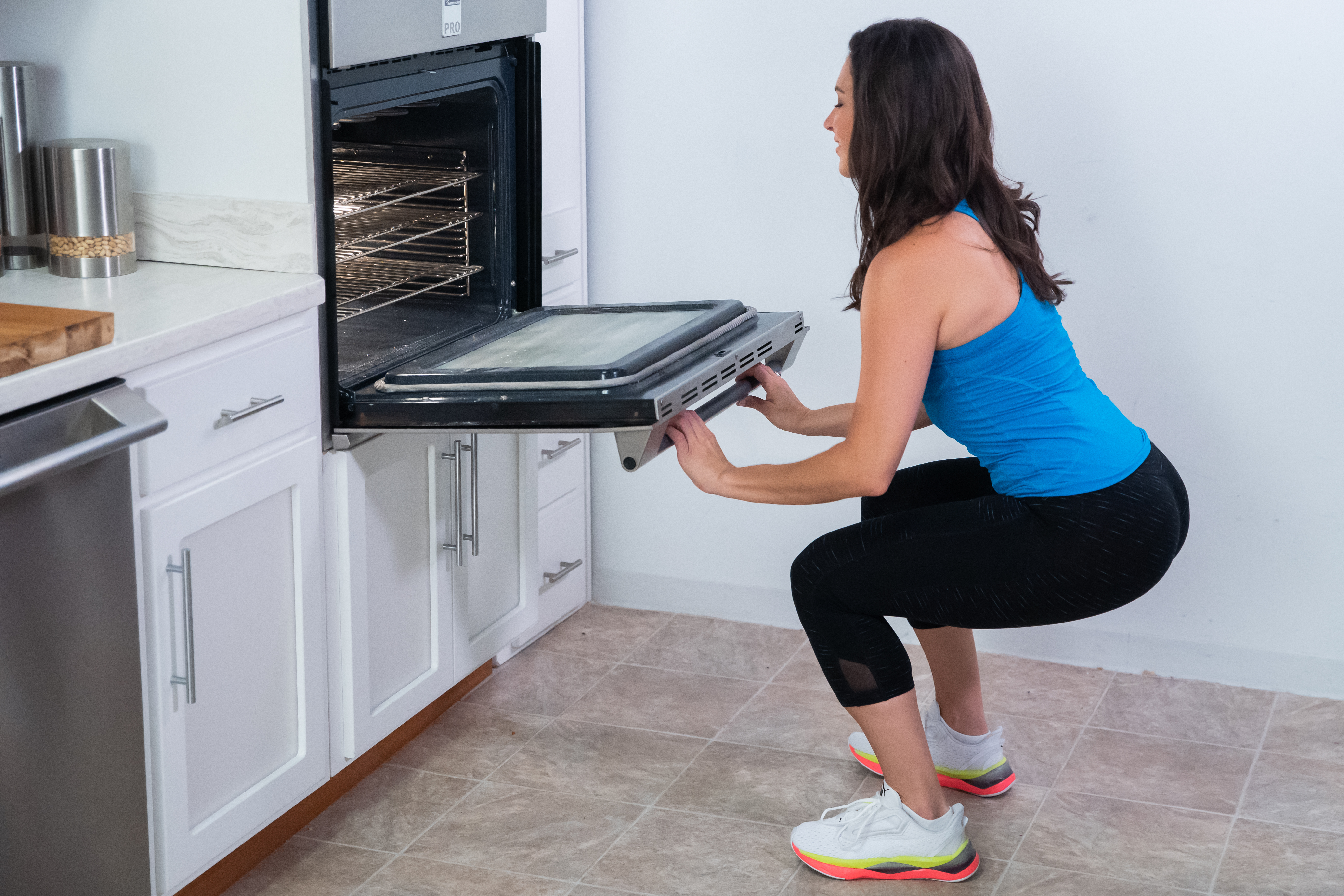 Don't just bend down to place items in the oven. Try this squat exercise instead when opening and closing the oven door. Remember to gently place your fingers on the door; never use it to pull yourself up.