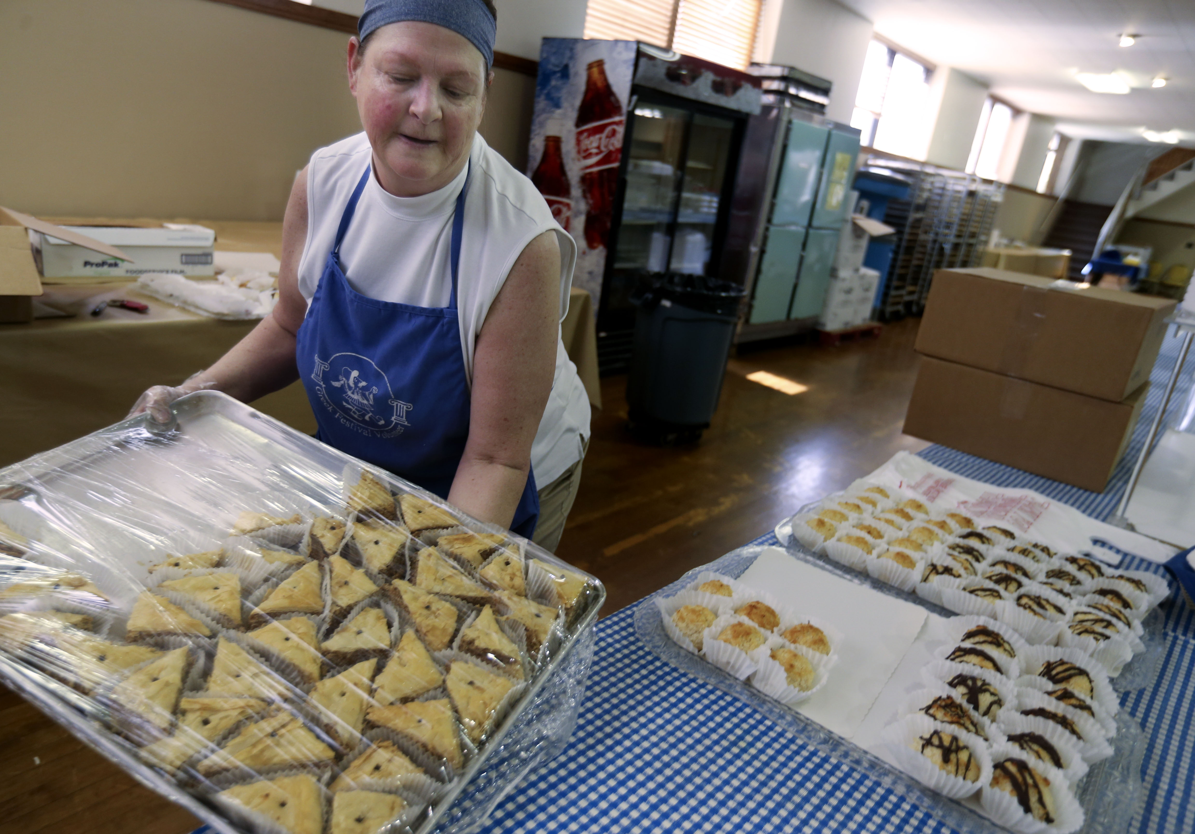 Jolene Vasilias organizes Greek pastries while preparing for this weekend's Greek Festival at the Holy Trinity Greek Orthodox Church in Salt Lake City on Thursday, Sept. 5, 2019. This weekend the city will play host to the Greek Festival, teh FanX, the Utah State Fair and the Vans Park Series World Championships.